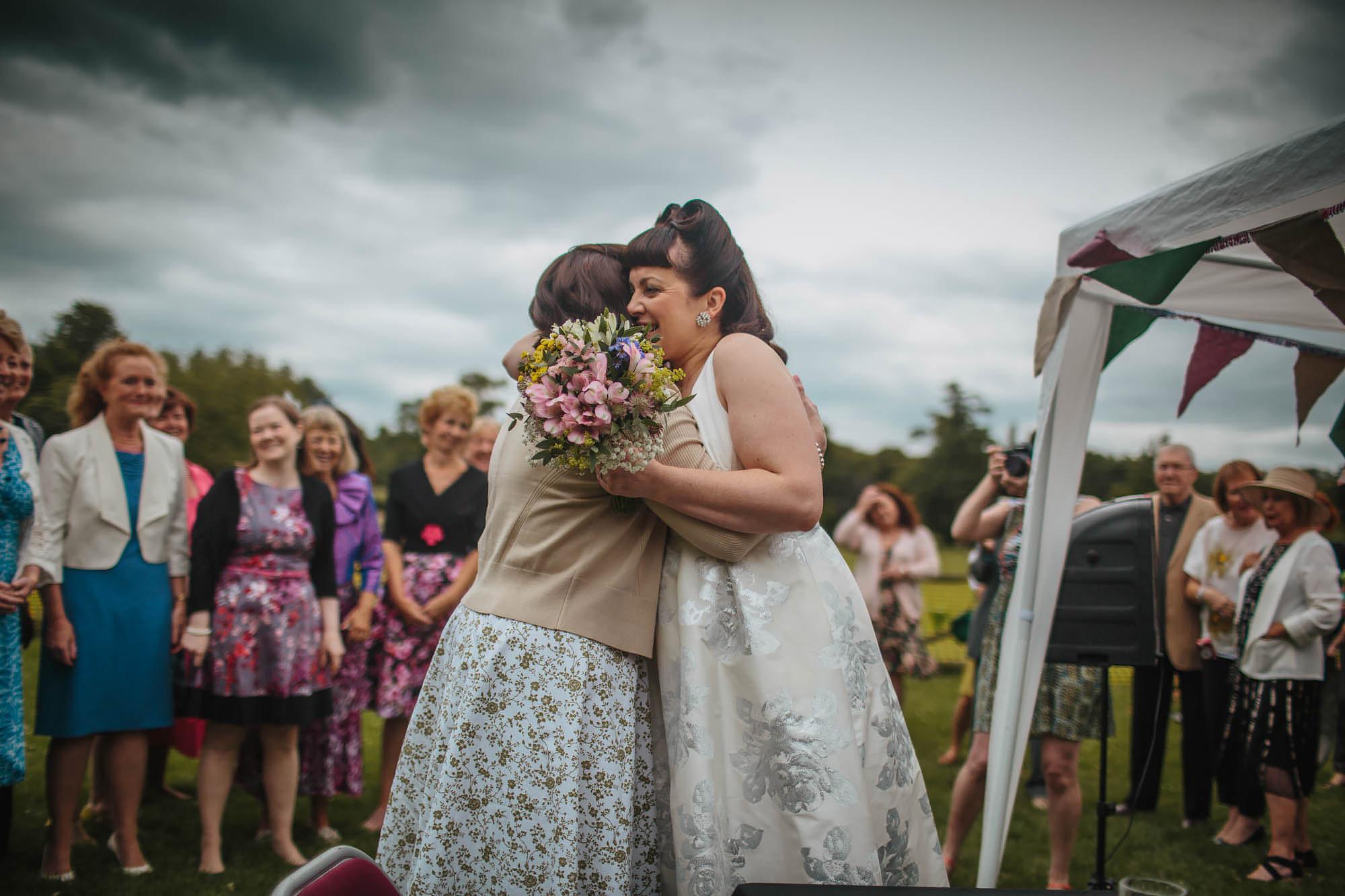 Leeds Yorkshire Wedding Photographer Hug Bride Sister