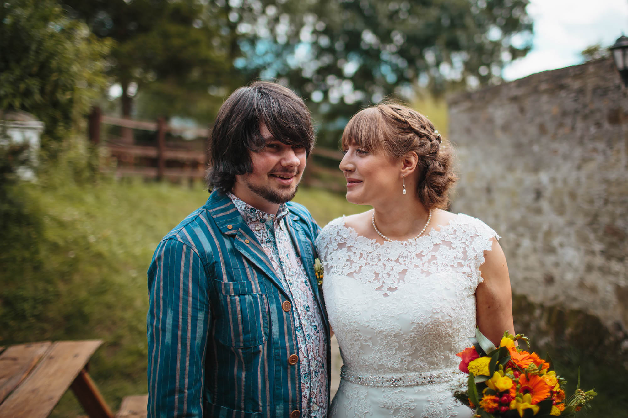 Bride and groom portrait at Craven Arms Cruck Barn in Yorkshire