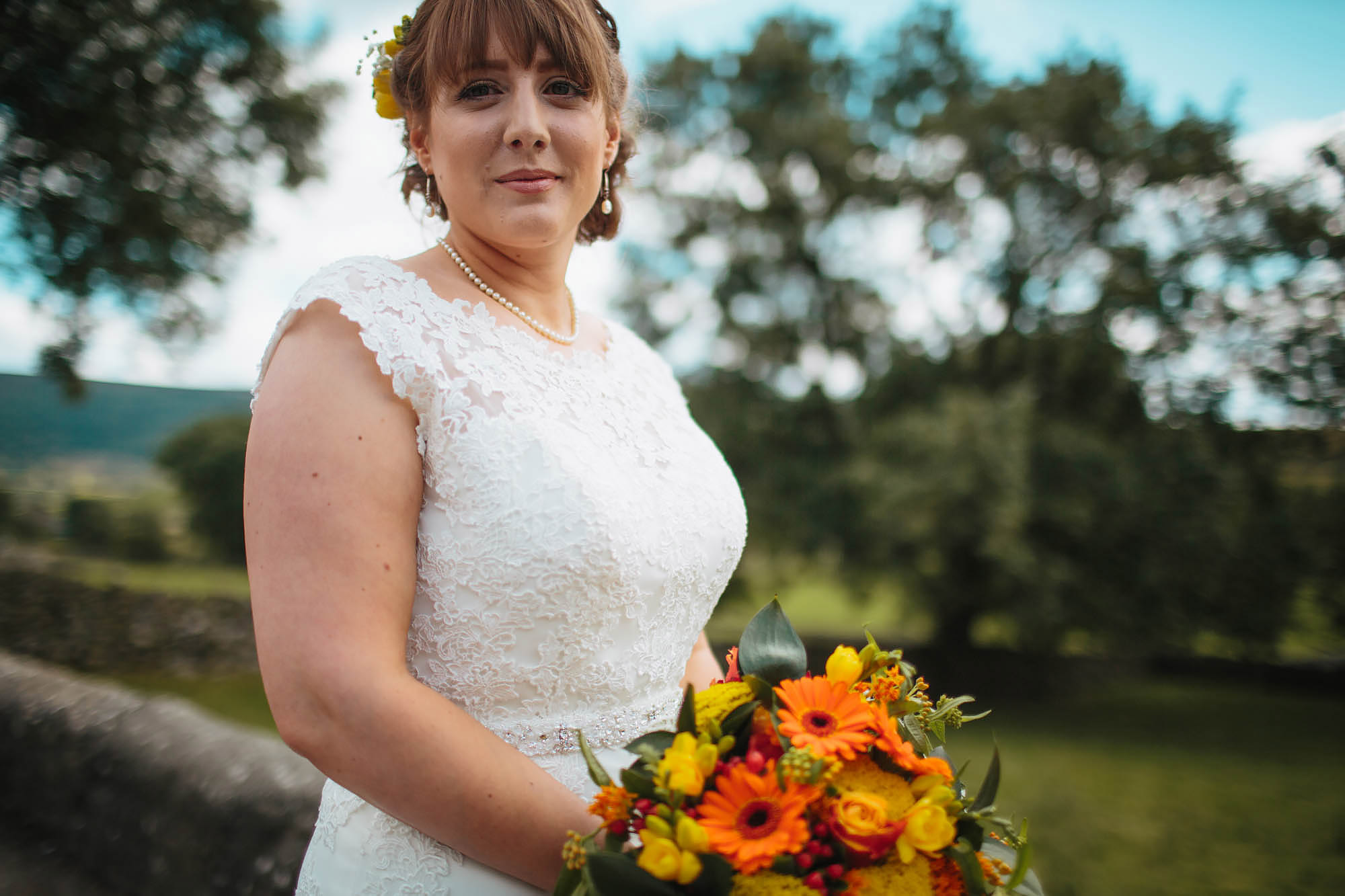 Bride poses with her bouquet in Yorkshire Dales