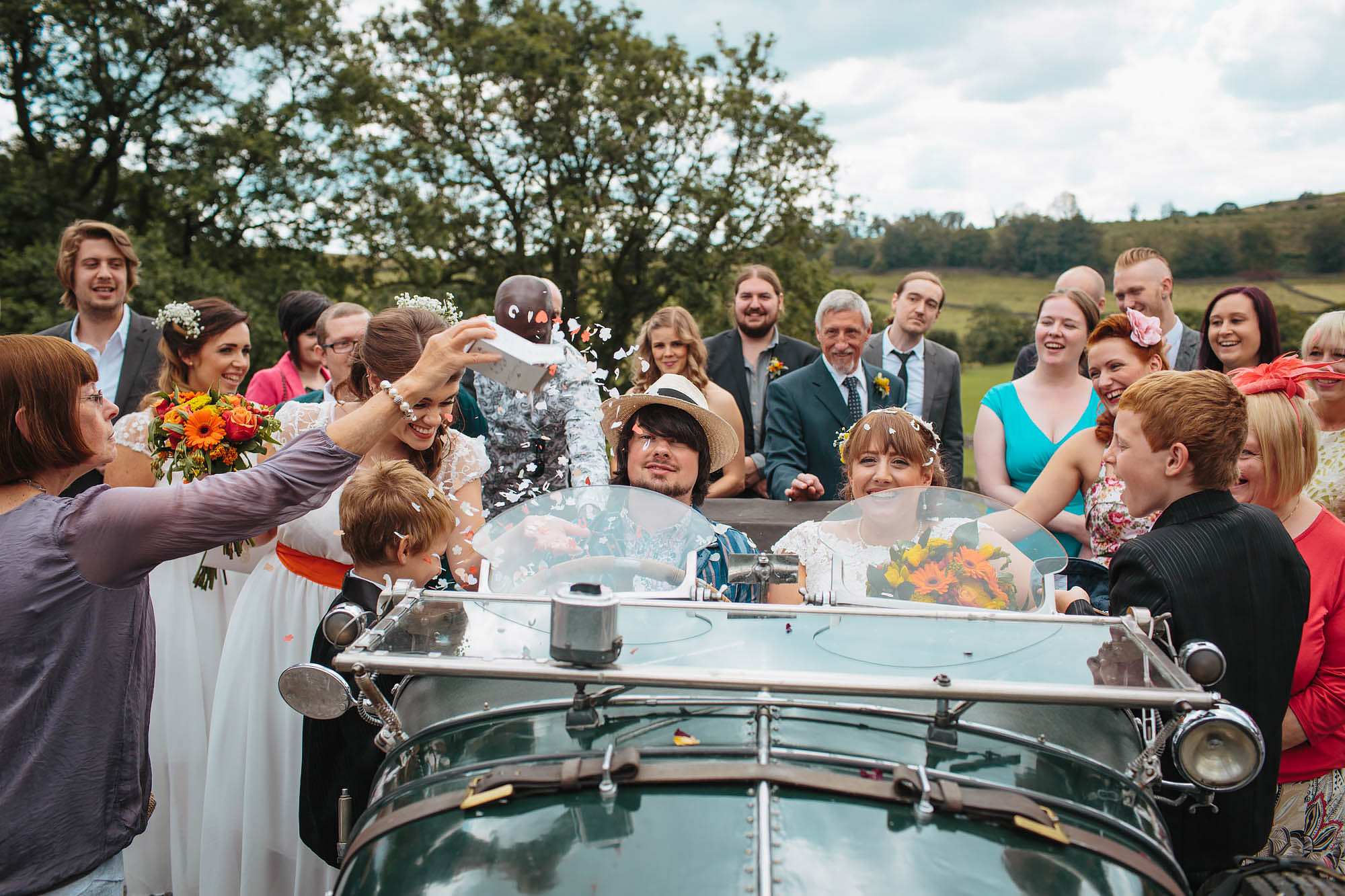 Bride and groom in a vintage car at a Yorkshire dales wedding