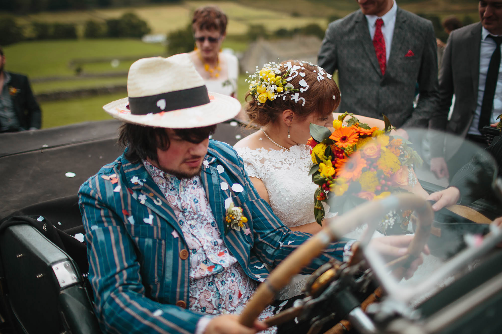 Groom wedding portrait in a vintage car in Yorkshire Dales