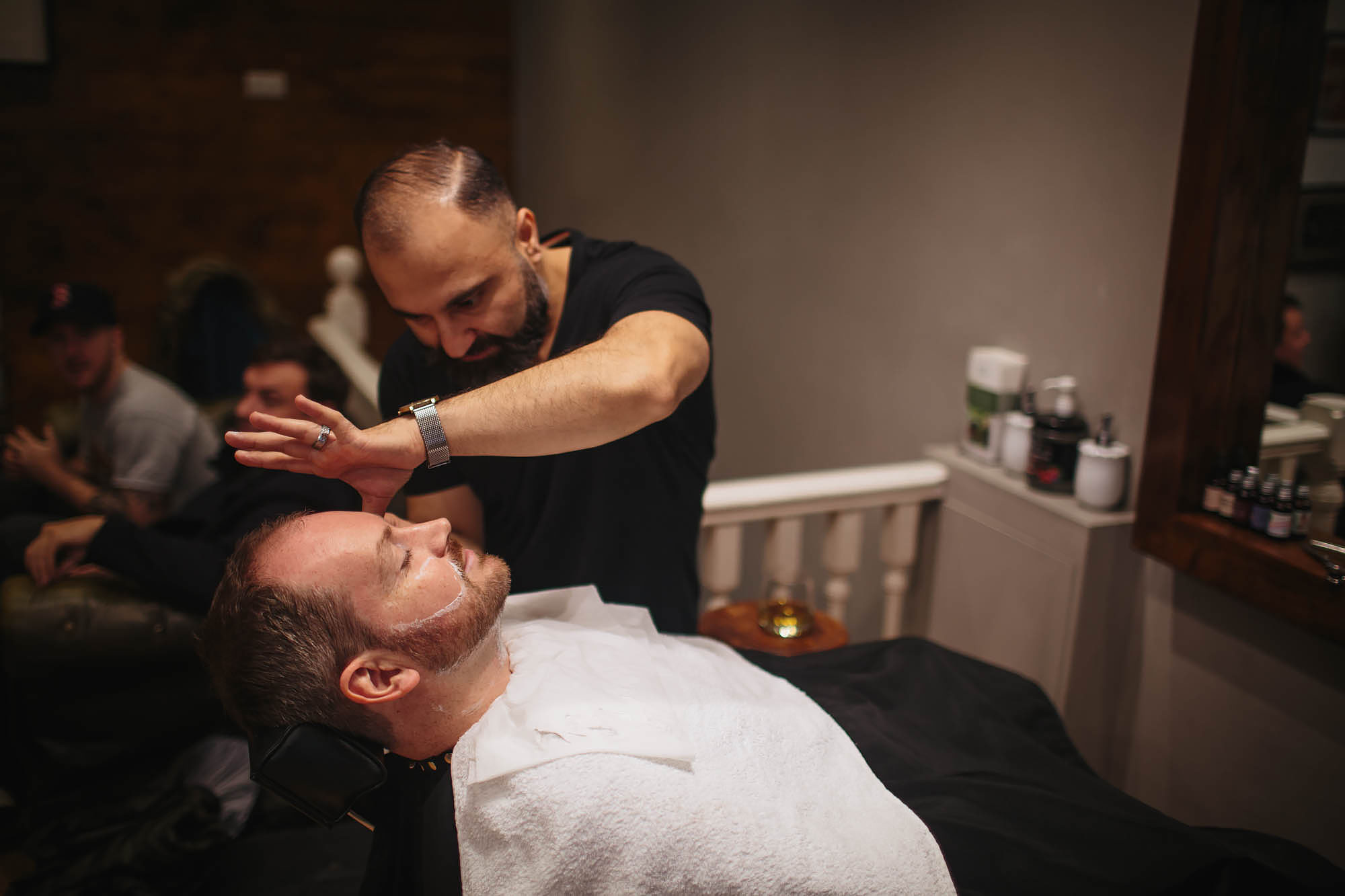 Groom has a wet shave for his wedding at Remedy Hairdressers