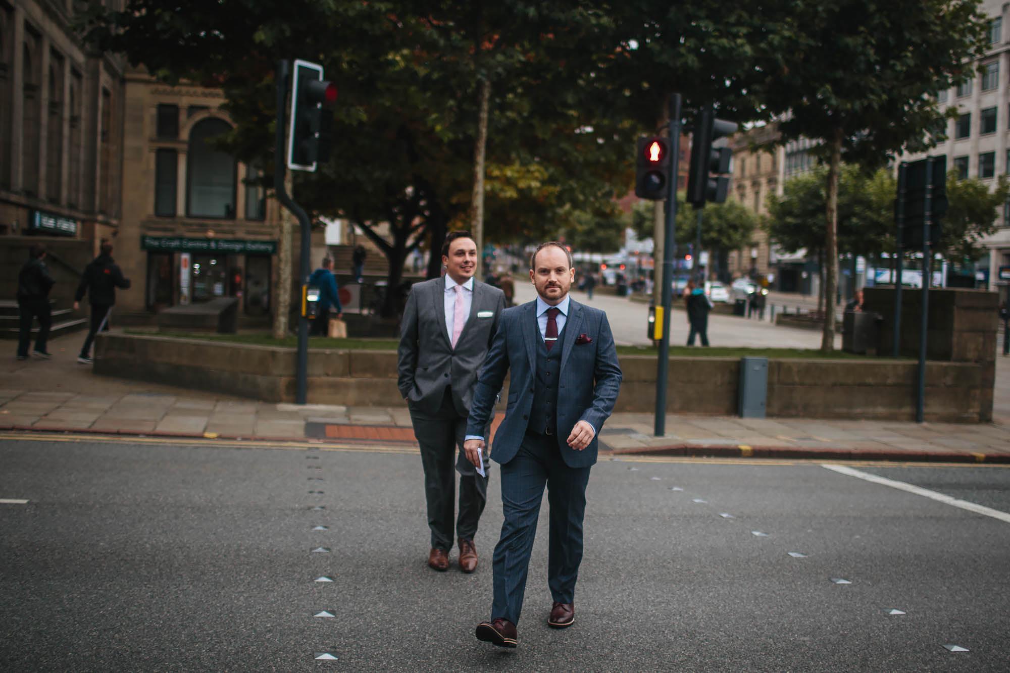 Groom walks to his wedding at Leeds Town Hall