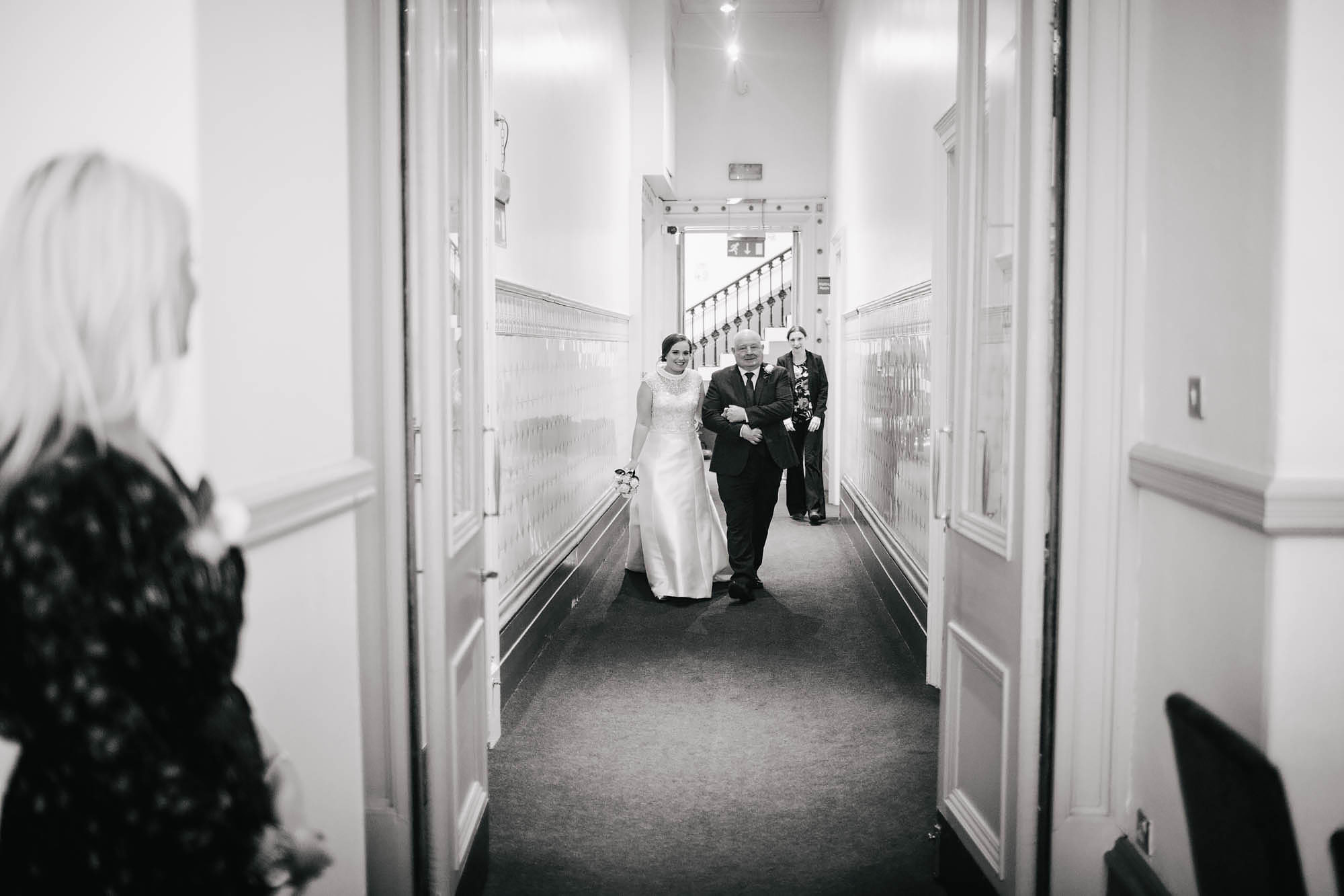 Bride and father walk down the aisle on her wedding day