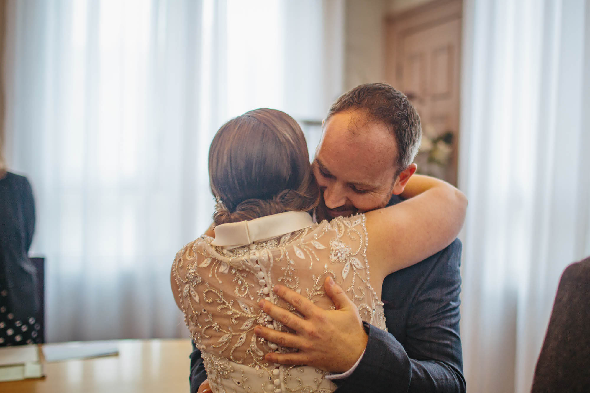 Bride and groom hug at a Leeds Town Hall wedding