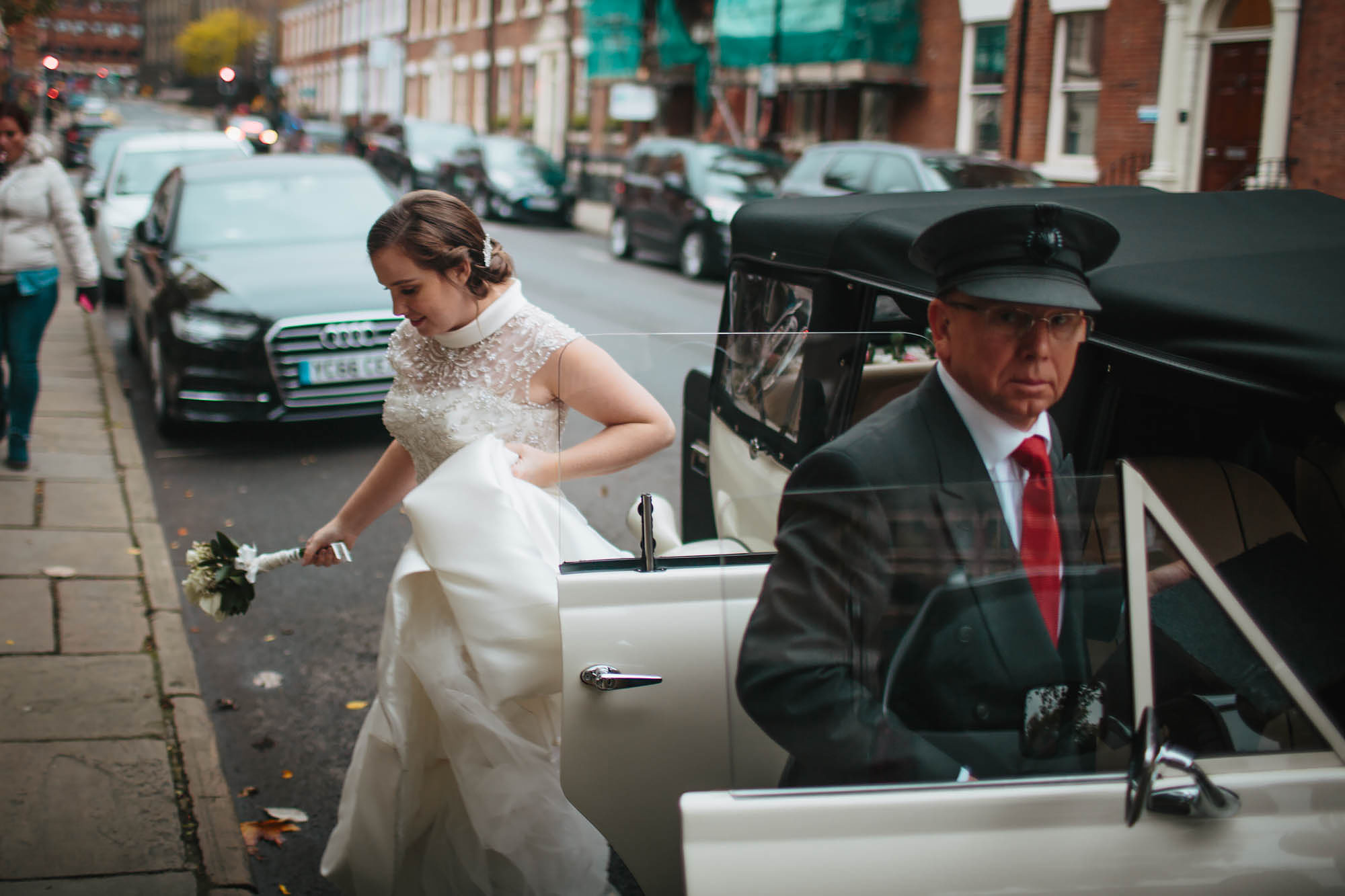 Bride getting out her wedding car in Leeds Yorkshire