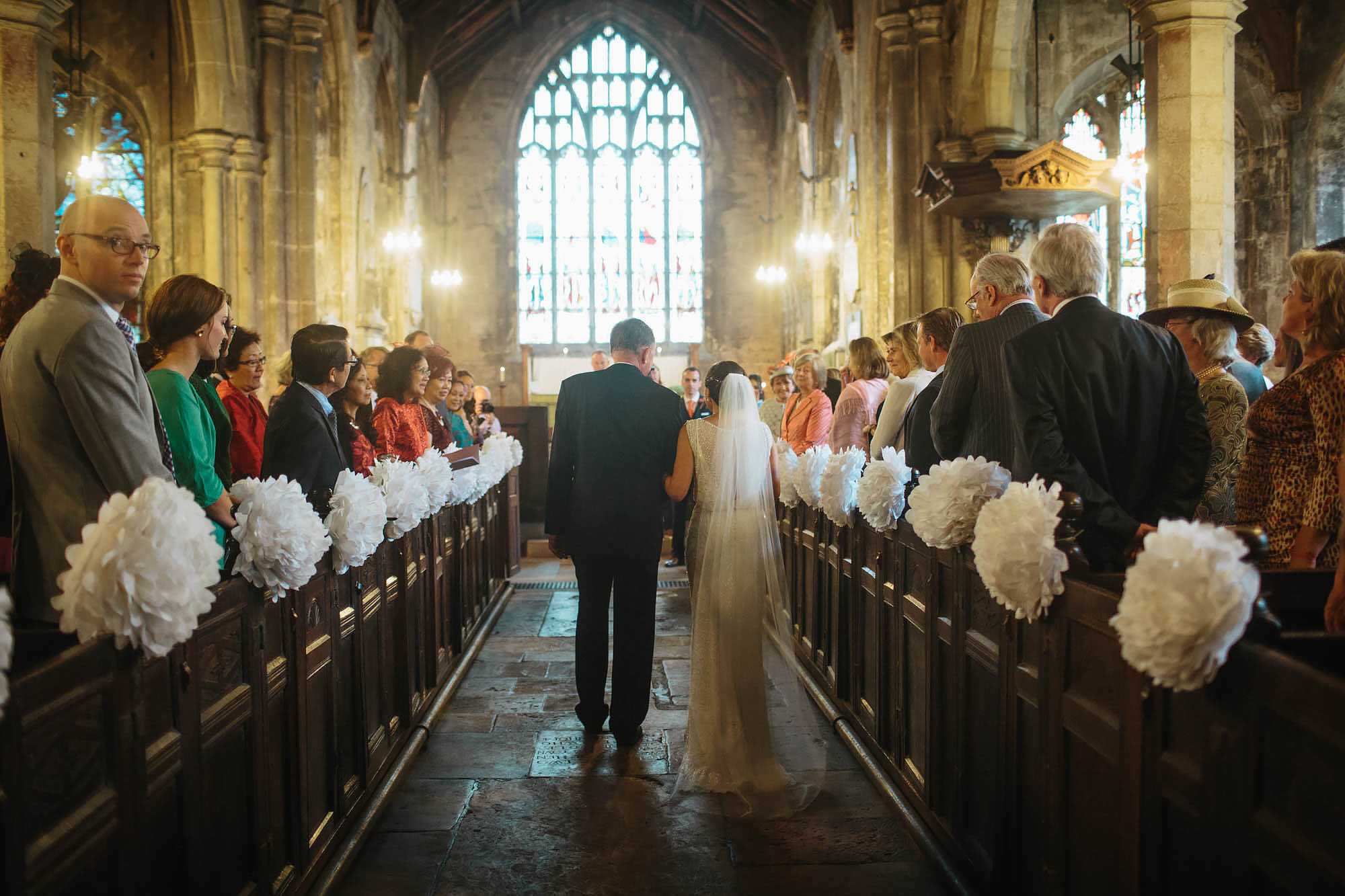 Father and bride walk down the aisle of the church in Yorkshire