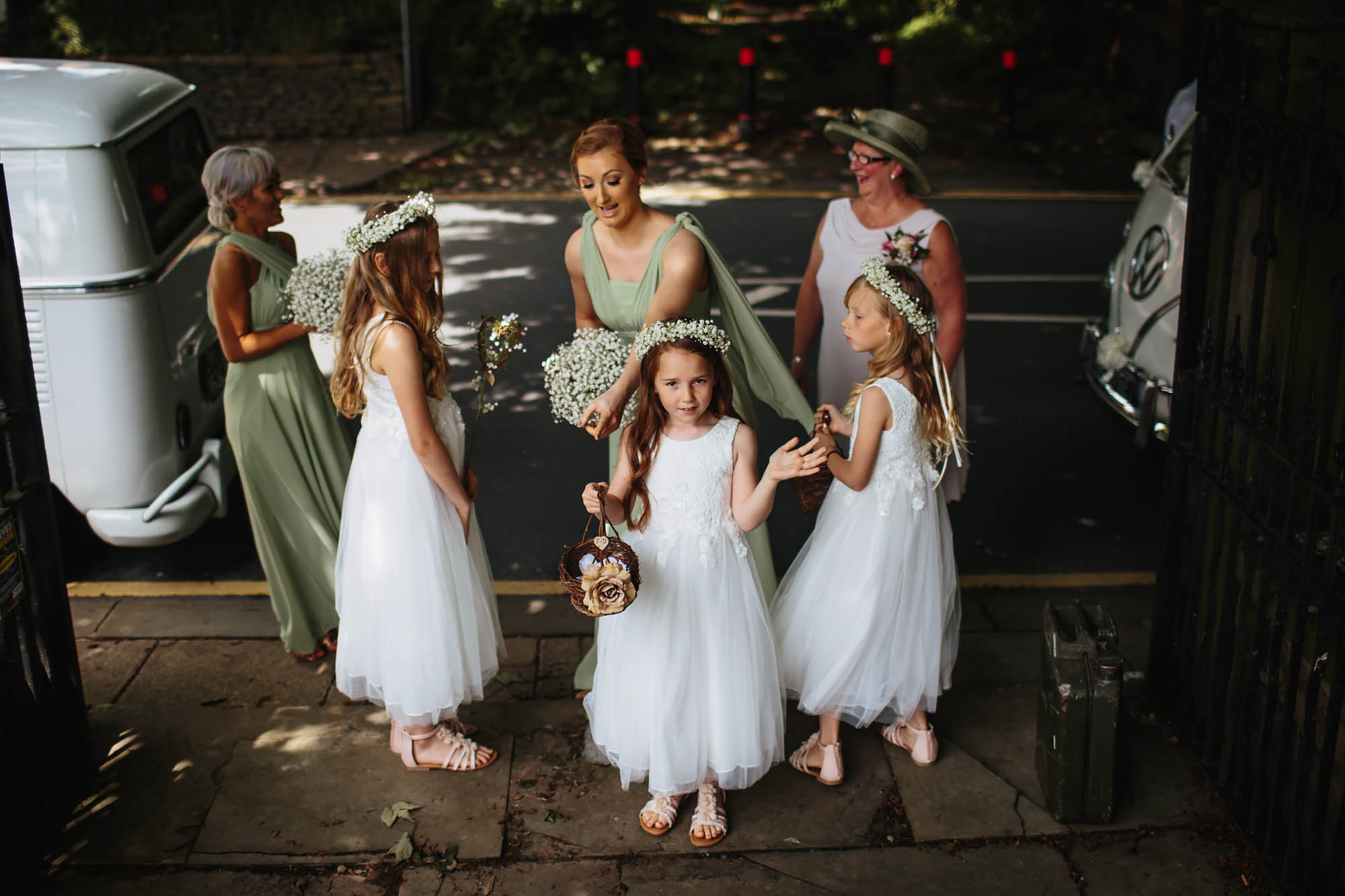 Bridesmaids and flower girls arrive at a wedding in Manchester