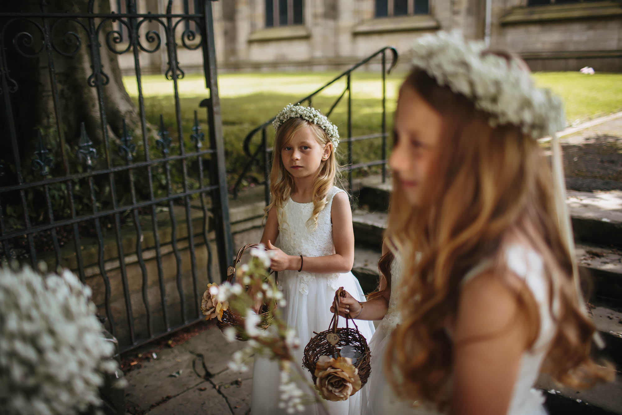 Flower girl looks nervous at the church in Manchester