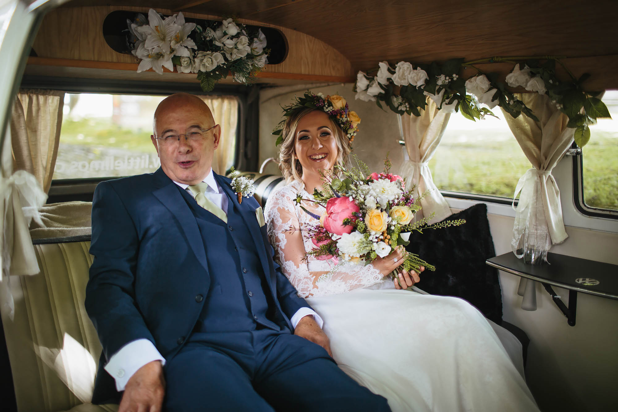 Bride and father arrive in VW camper van at a wedding