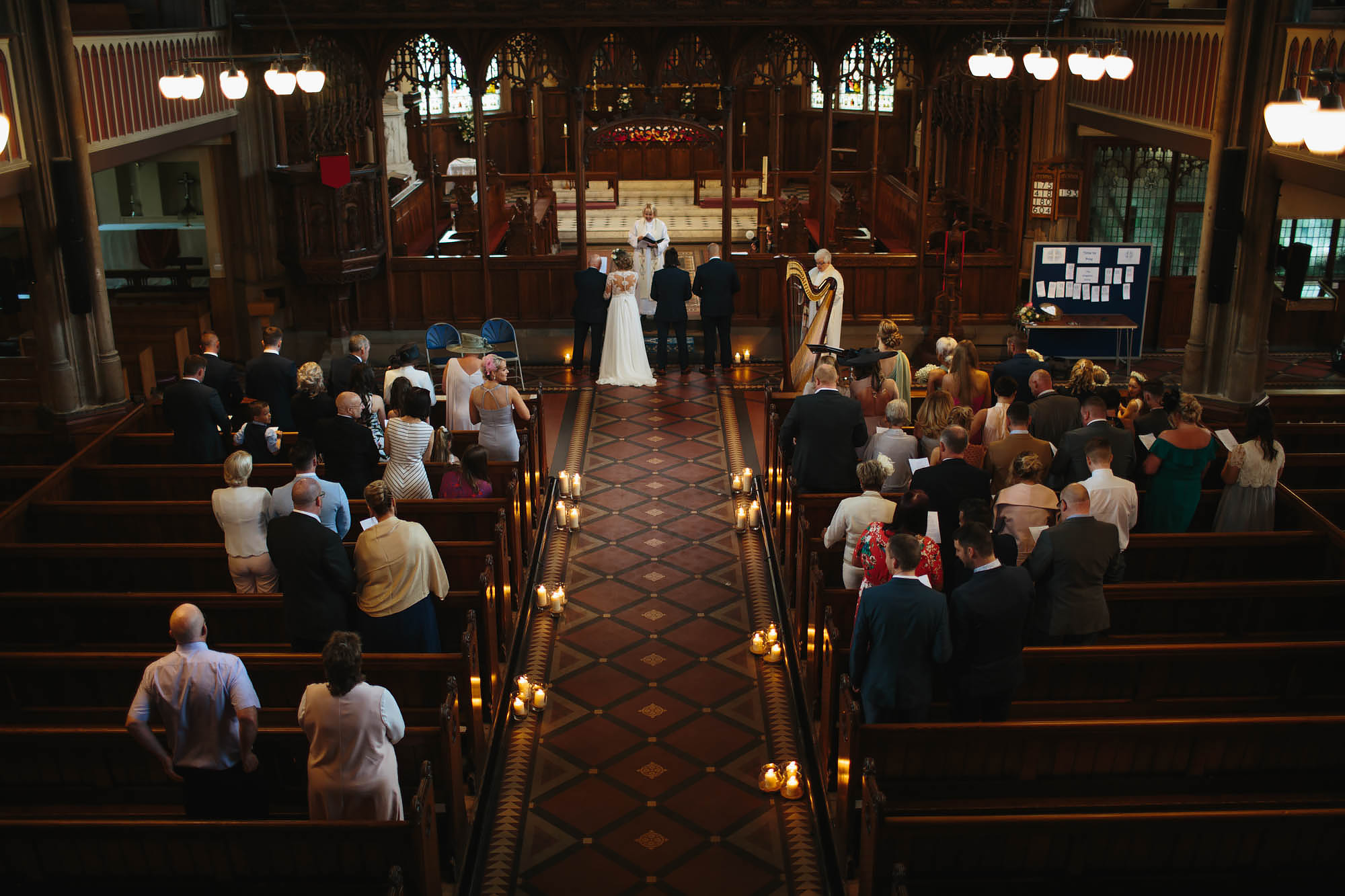 Bride and groom getting married in a church in Manchester
