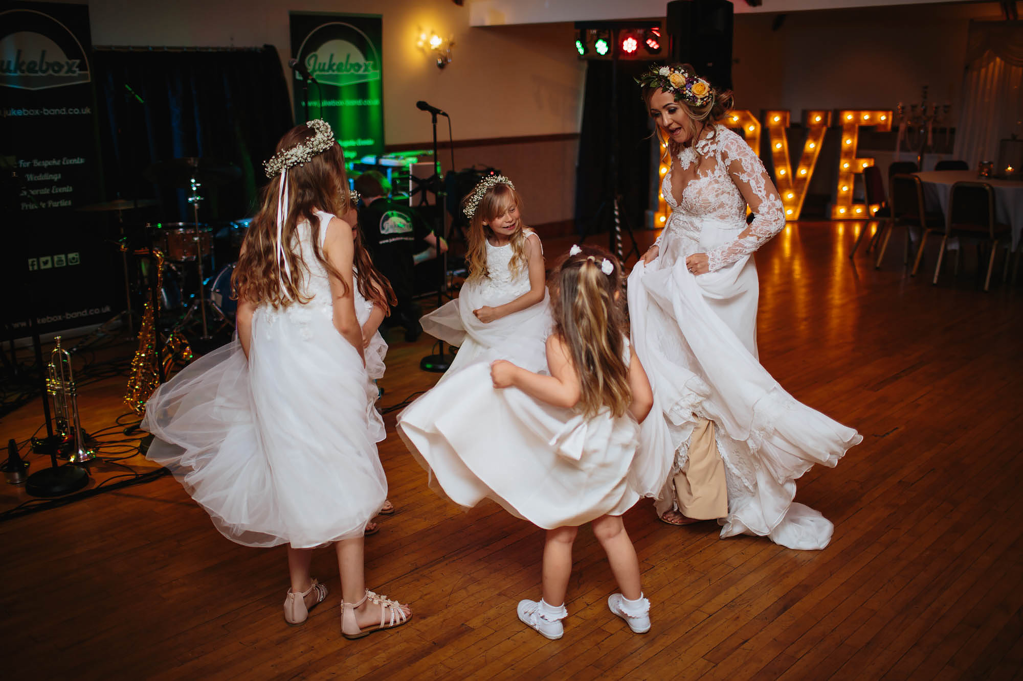Bride and bridesmaids dancing at a wedding in Manchester