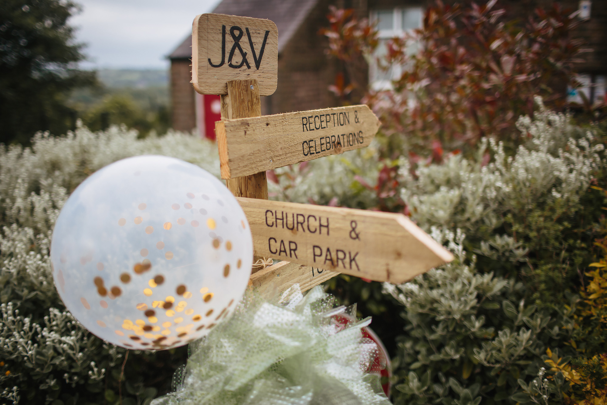 Wooden sign for a wedding pointing to the church
