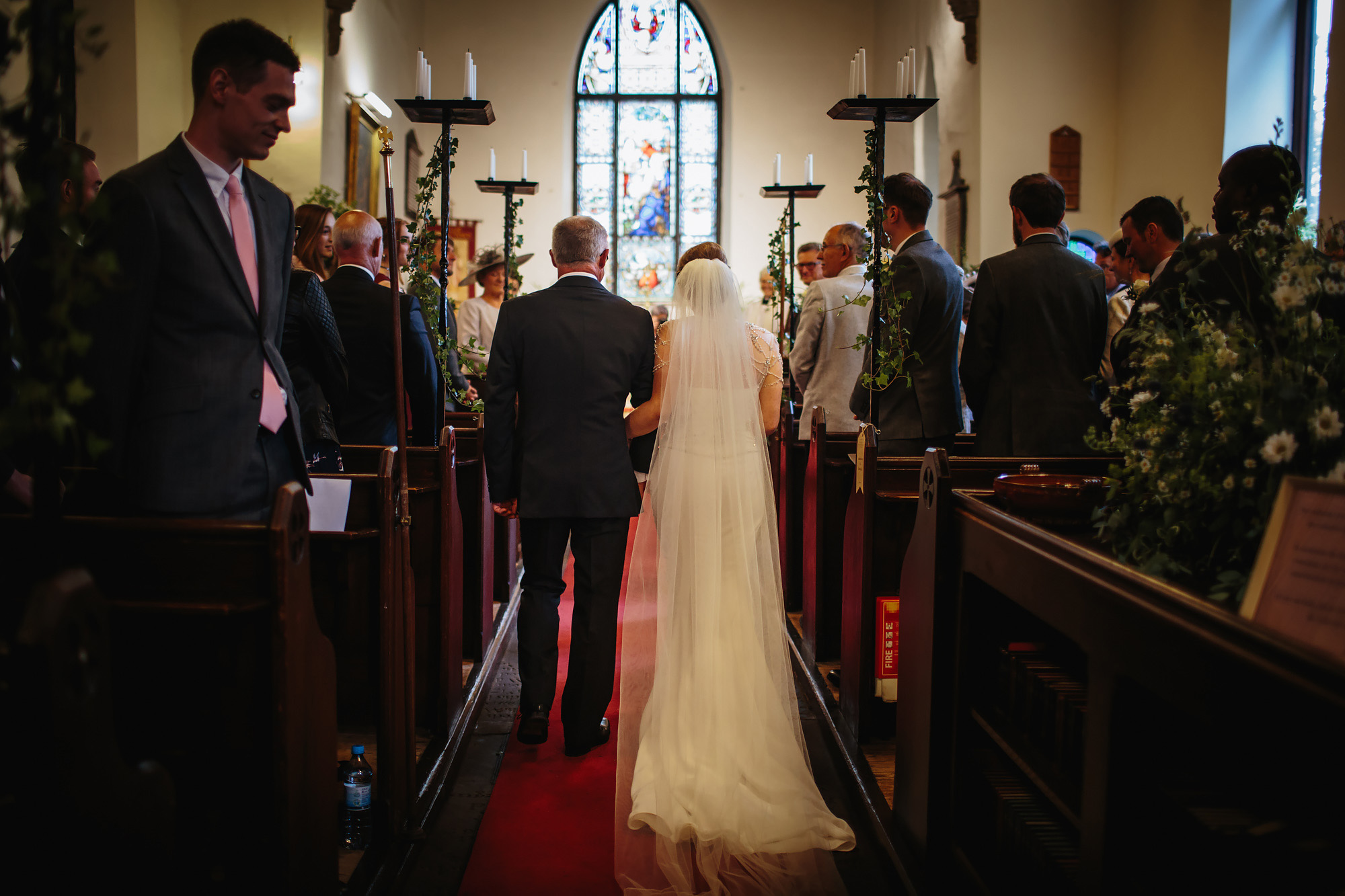 Bride and father walking down the aisle of the church in Lancashire