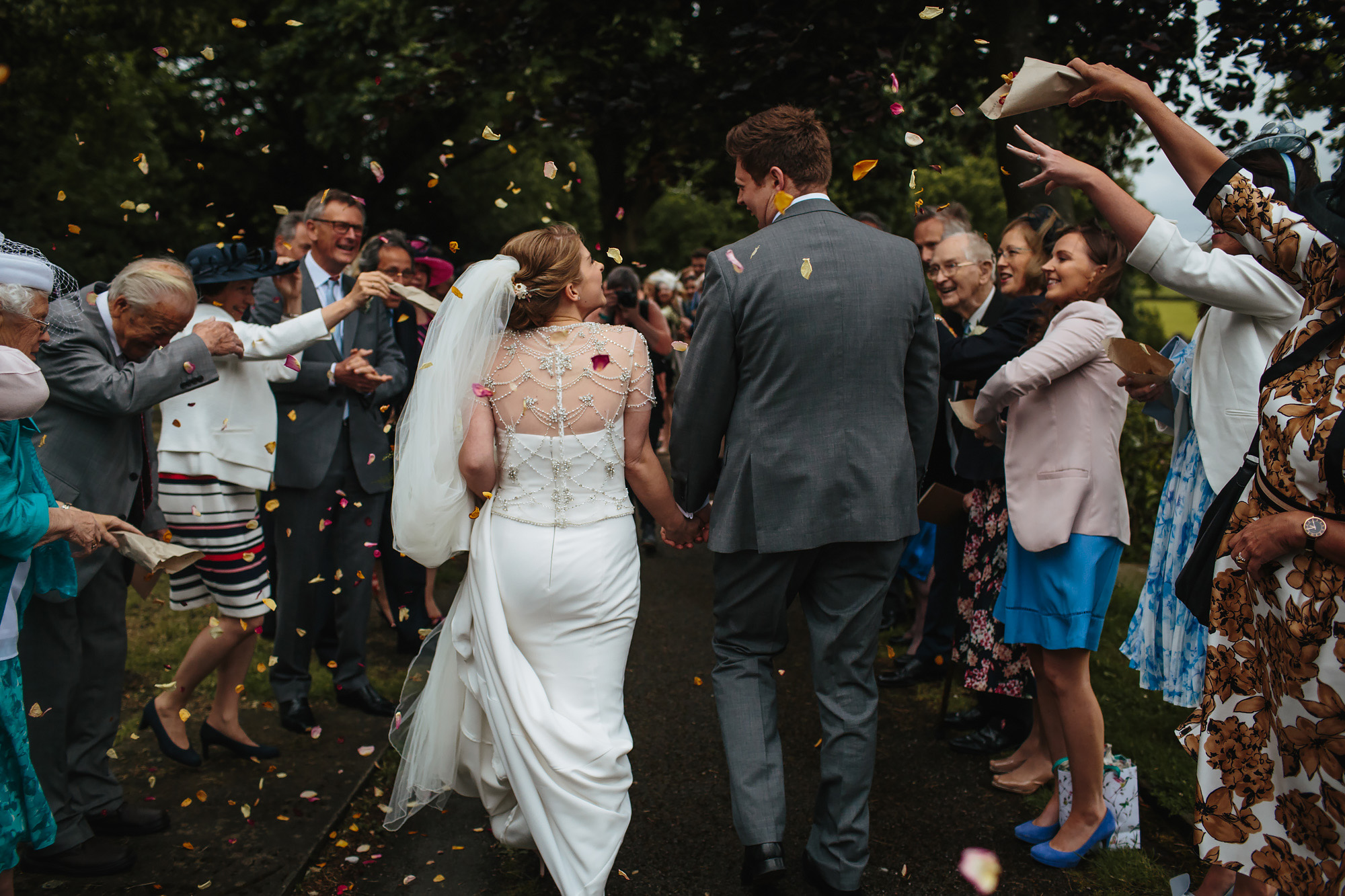 Throwing confetti on the Bride and Groom at a wedding