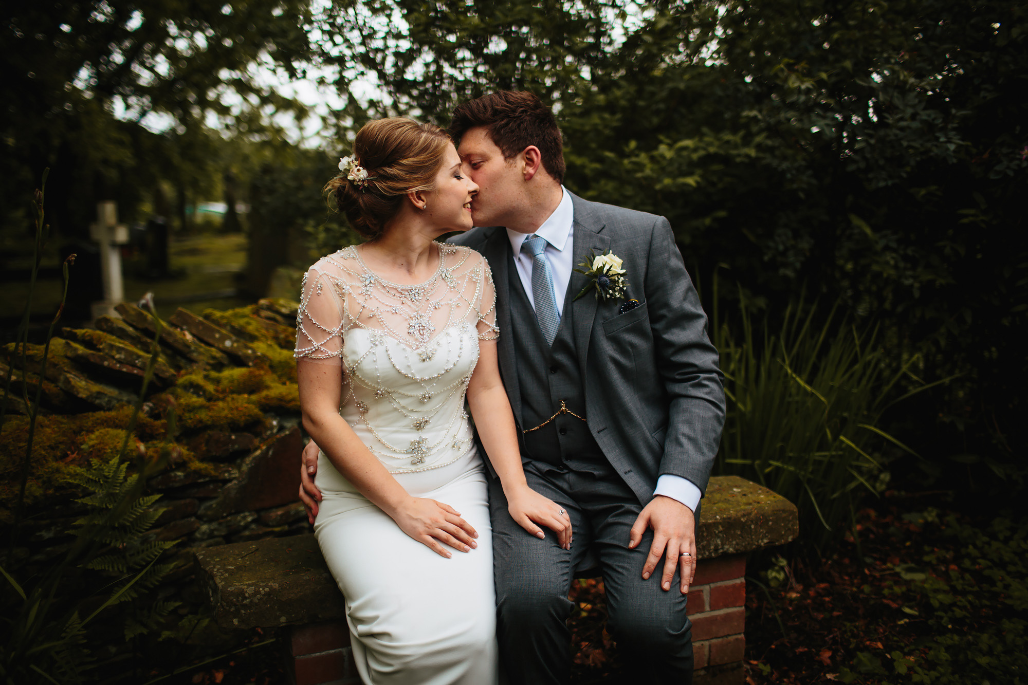 Bride and groom kissing for their portrait on a Lancashire wedding