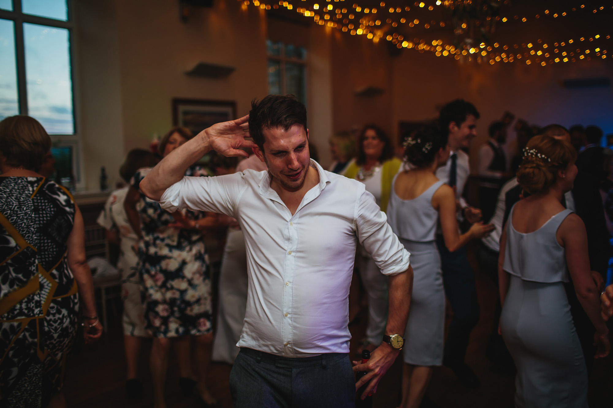 Sweaty man dances at a wedding and its funny