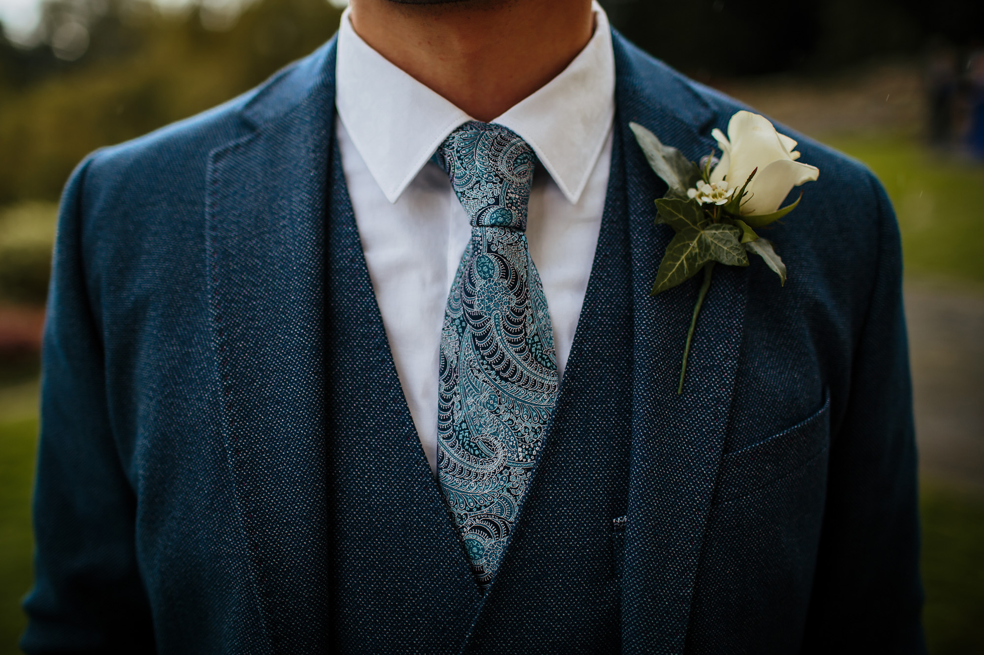 Close up of grooms suit with a buttonhole for the wedding
