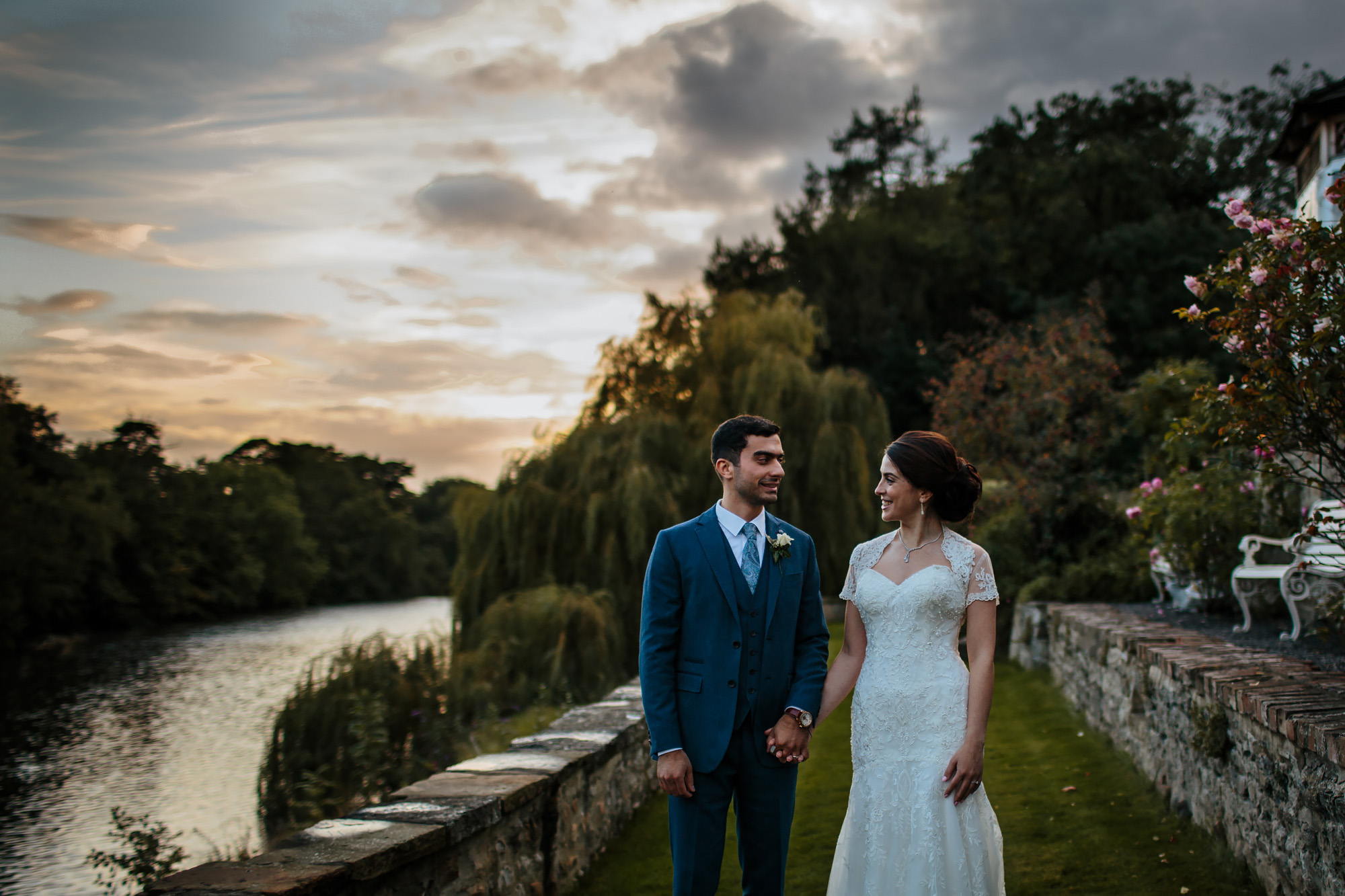 Portrait of the bride and groom at sunset by a river in Yorkshire