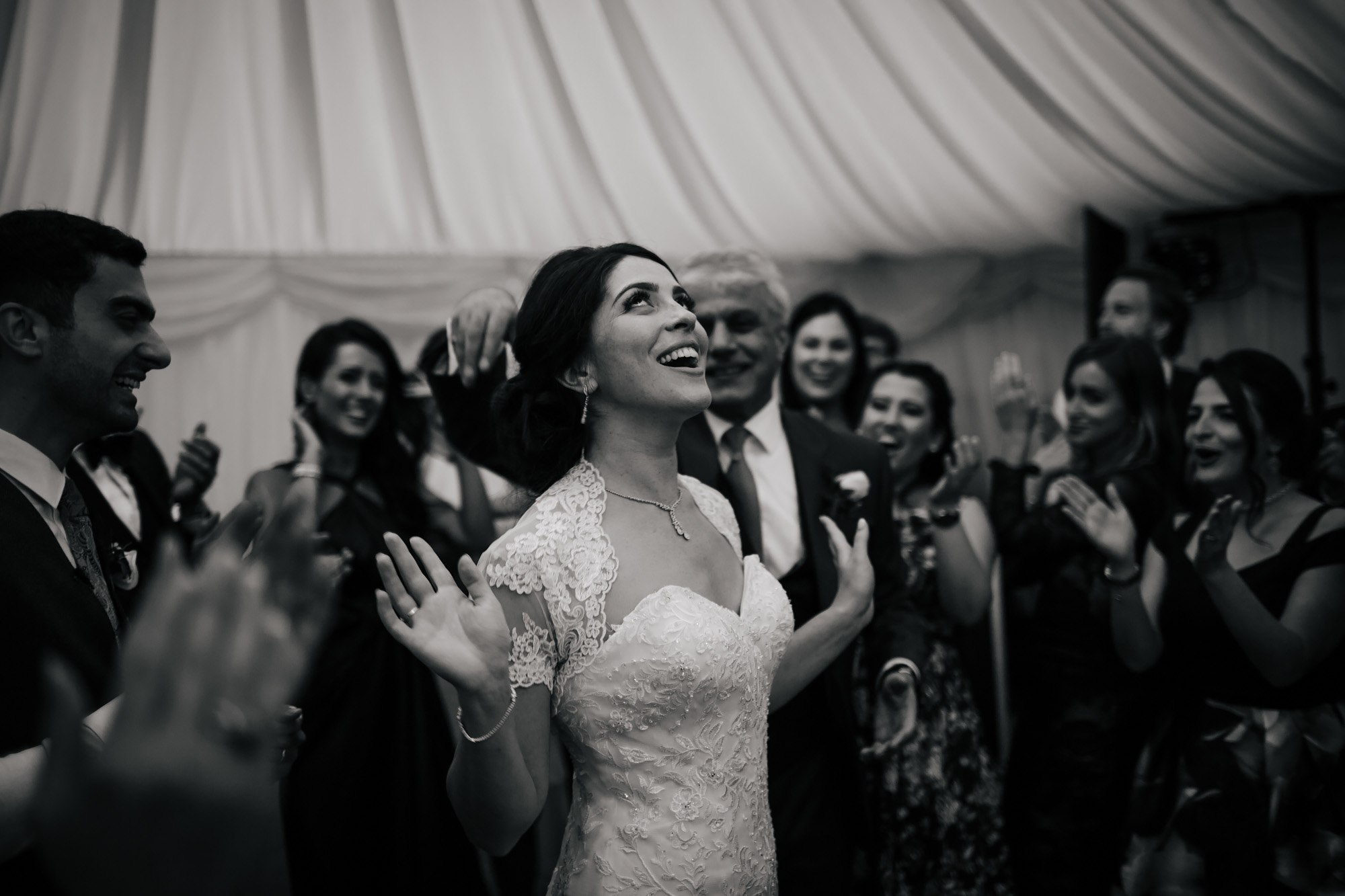 Bride dancing and laughing at a wedding