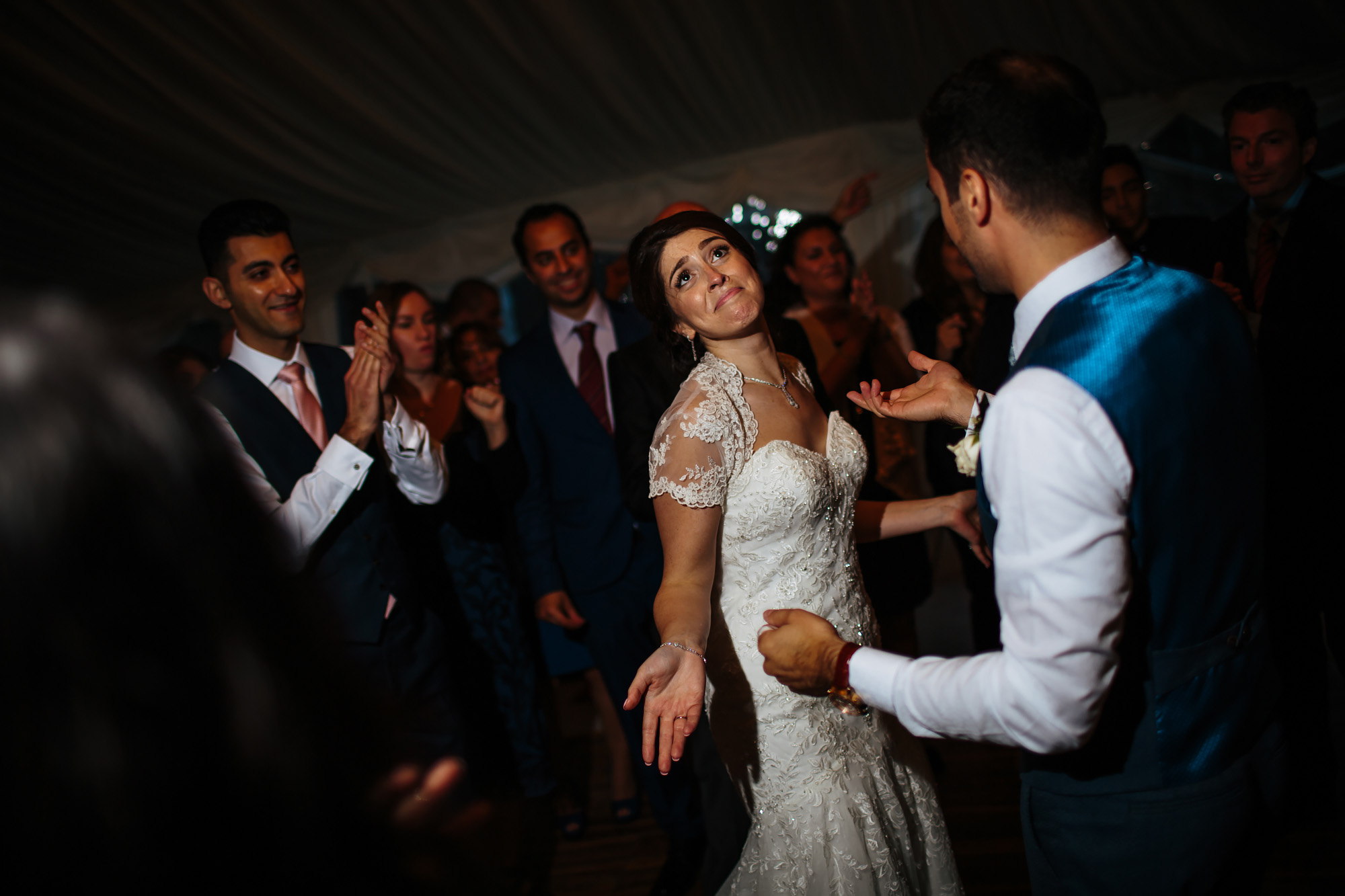 Bride laughing and dancing at a wedding