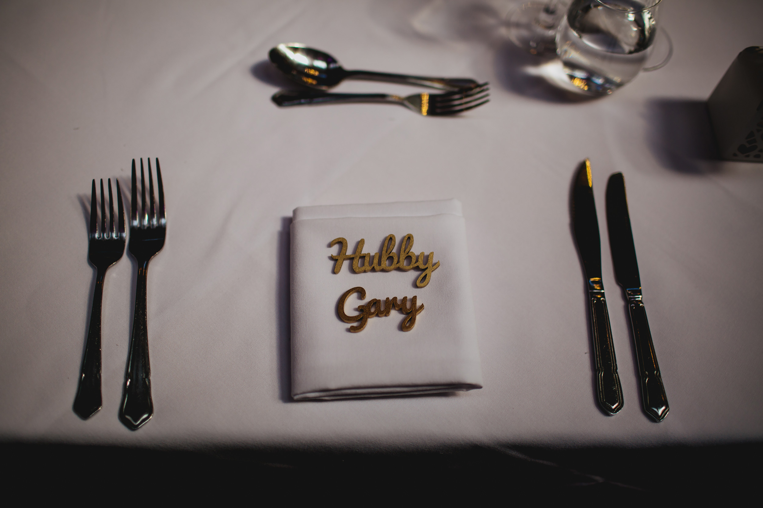 Groom place setting at his wedding