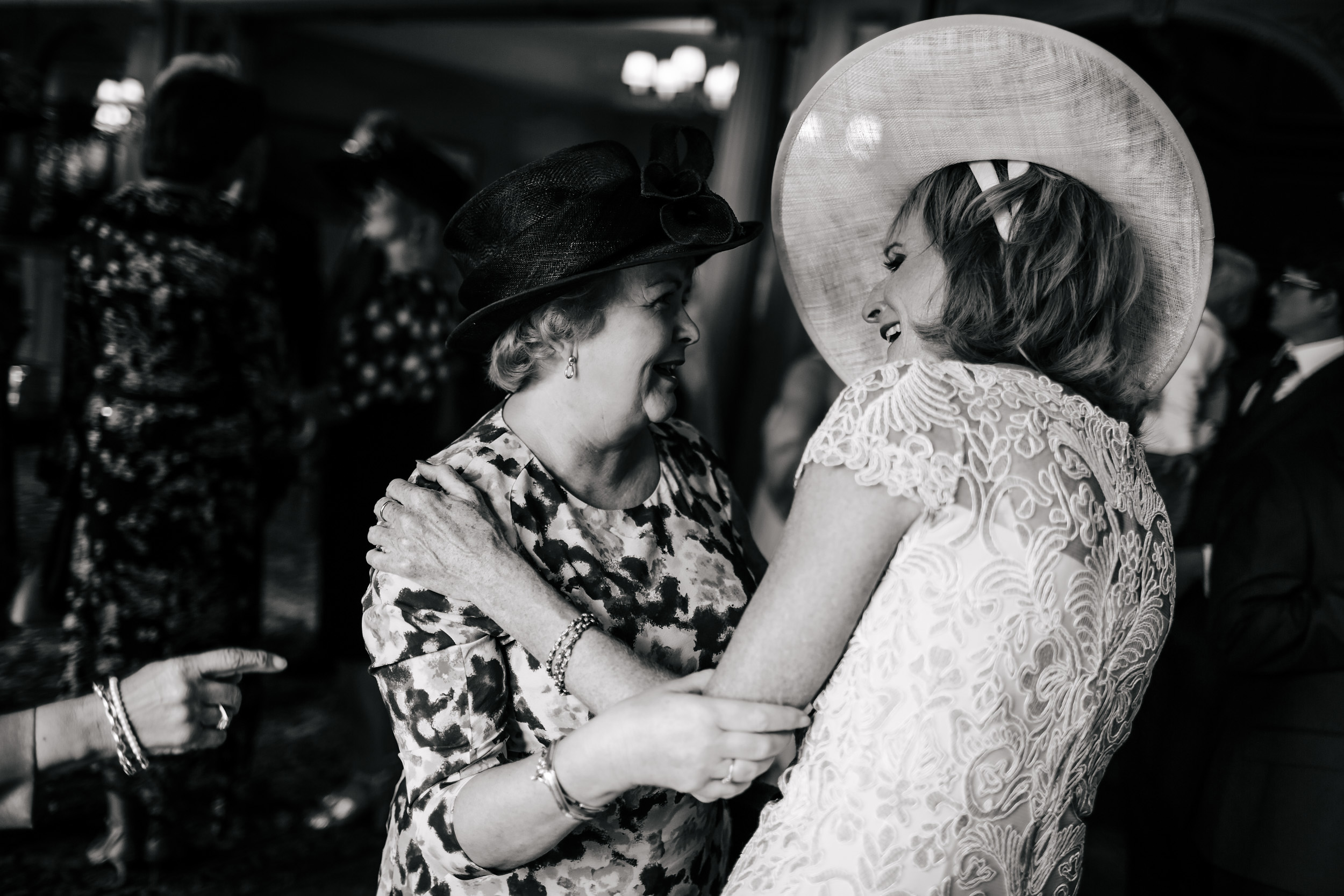 Brides mother laughs at her wedding at Thornton Manor Cheshire