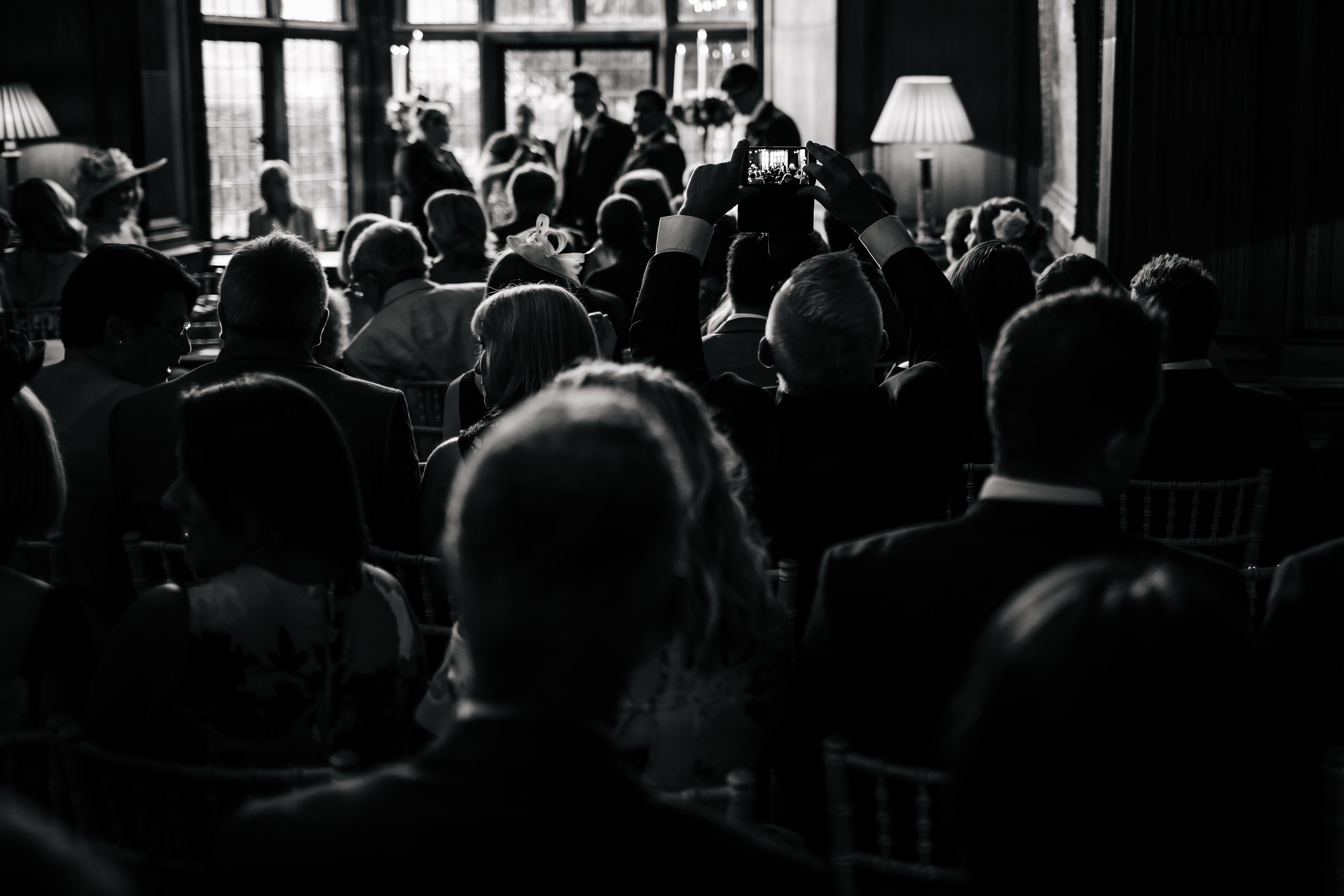 Black and white photo of guests at a wedding ceremony Thornton Manor