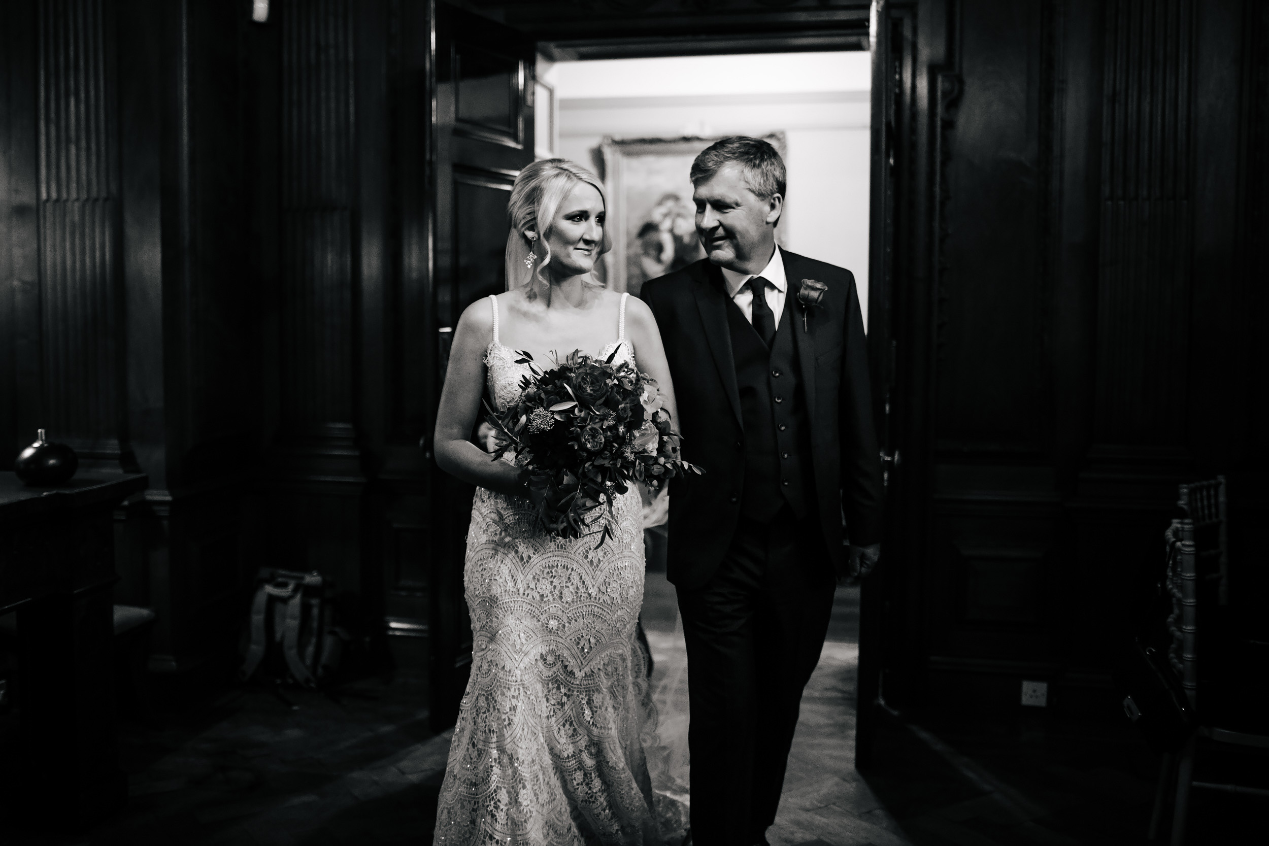 Bride enters wedding at Thornton Manor Cheshire