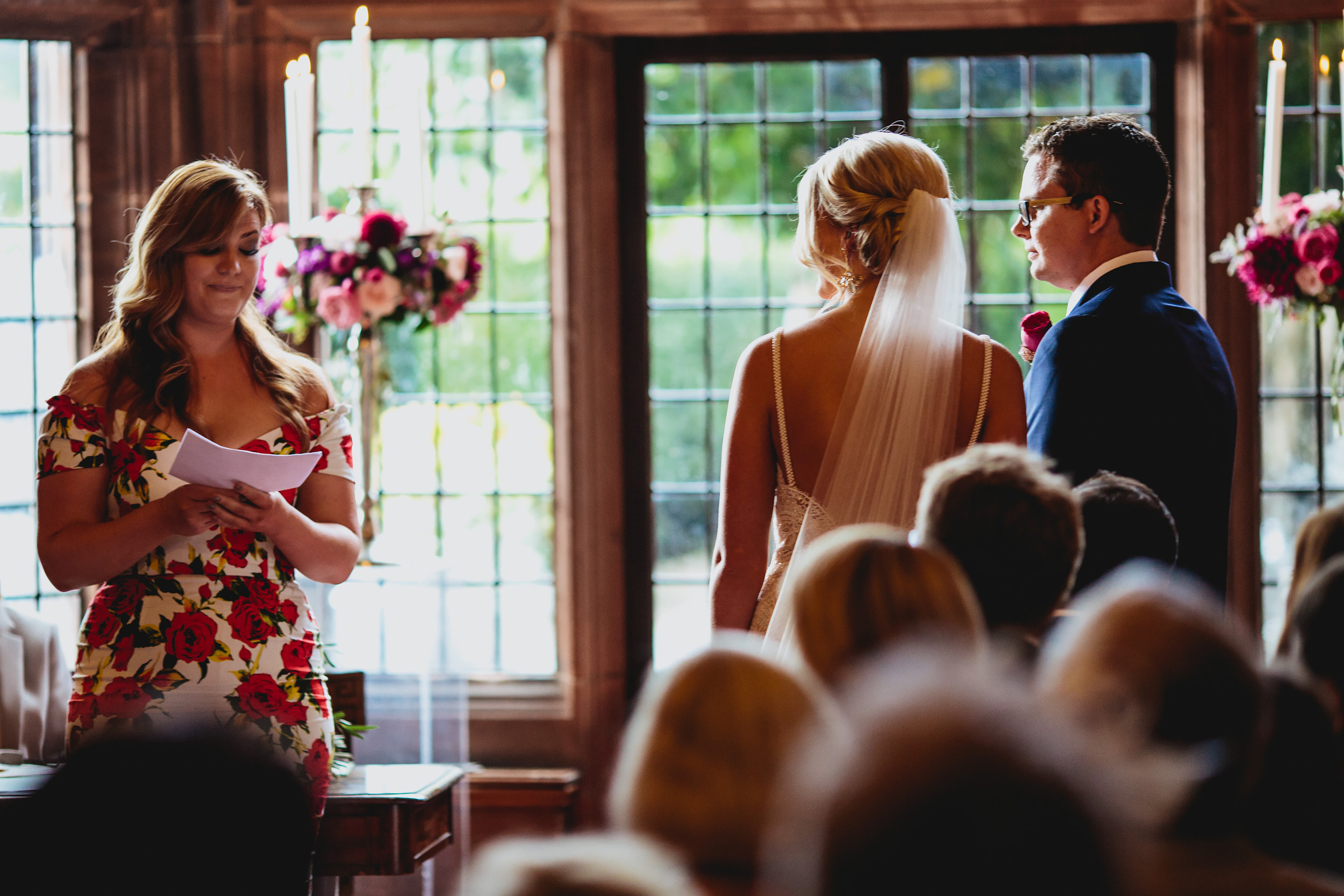 Guest reading during a wedding ceremony at Thornton Manor Cheshire