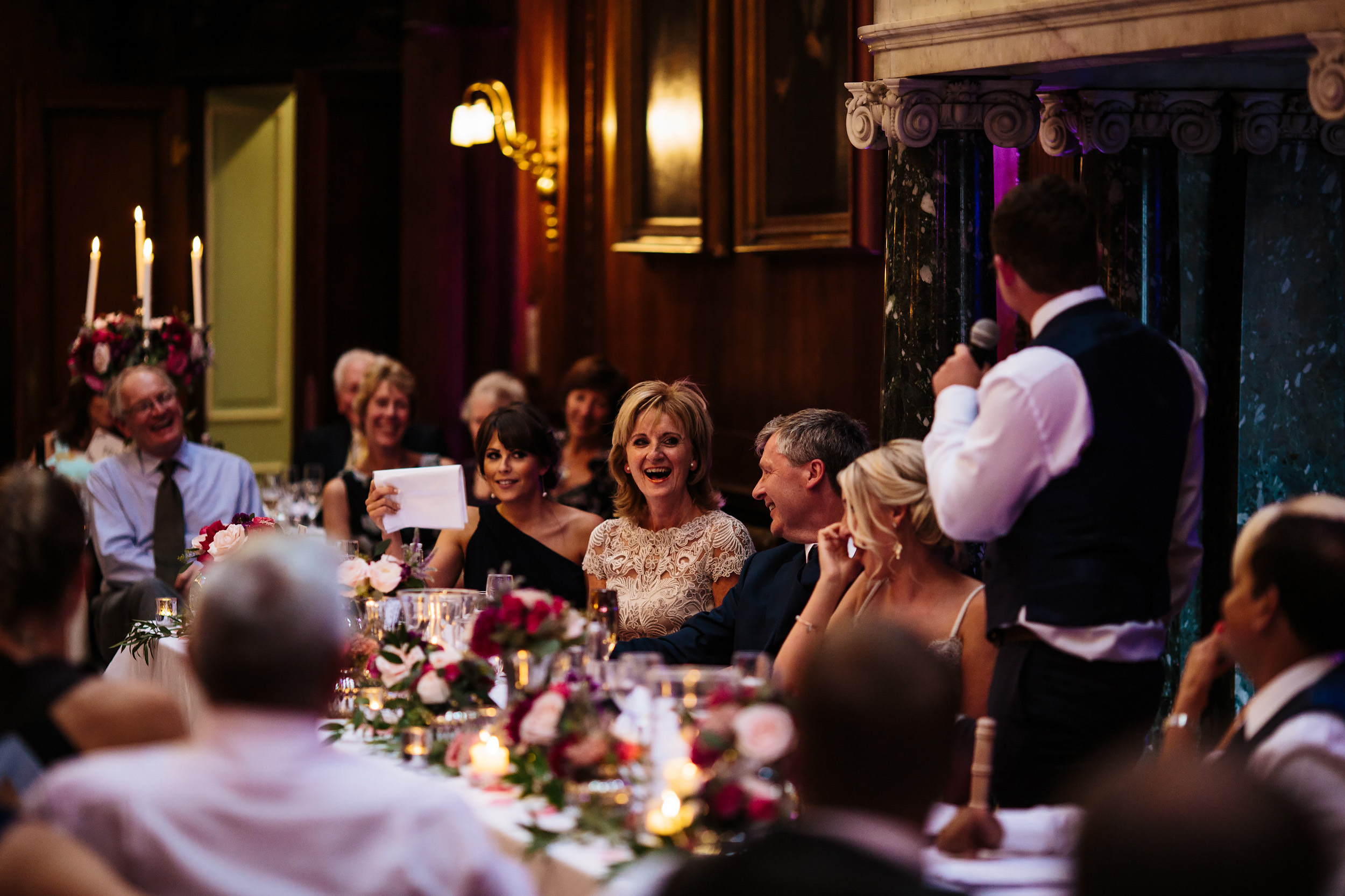Brides mother laughing during the grooms speech at a wedding