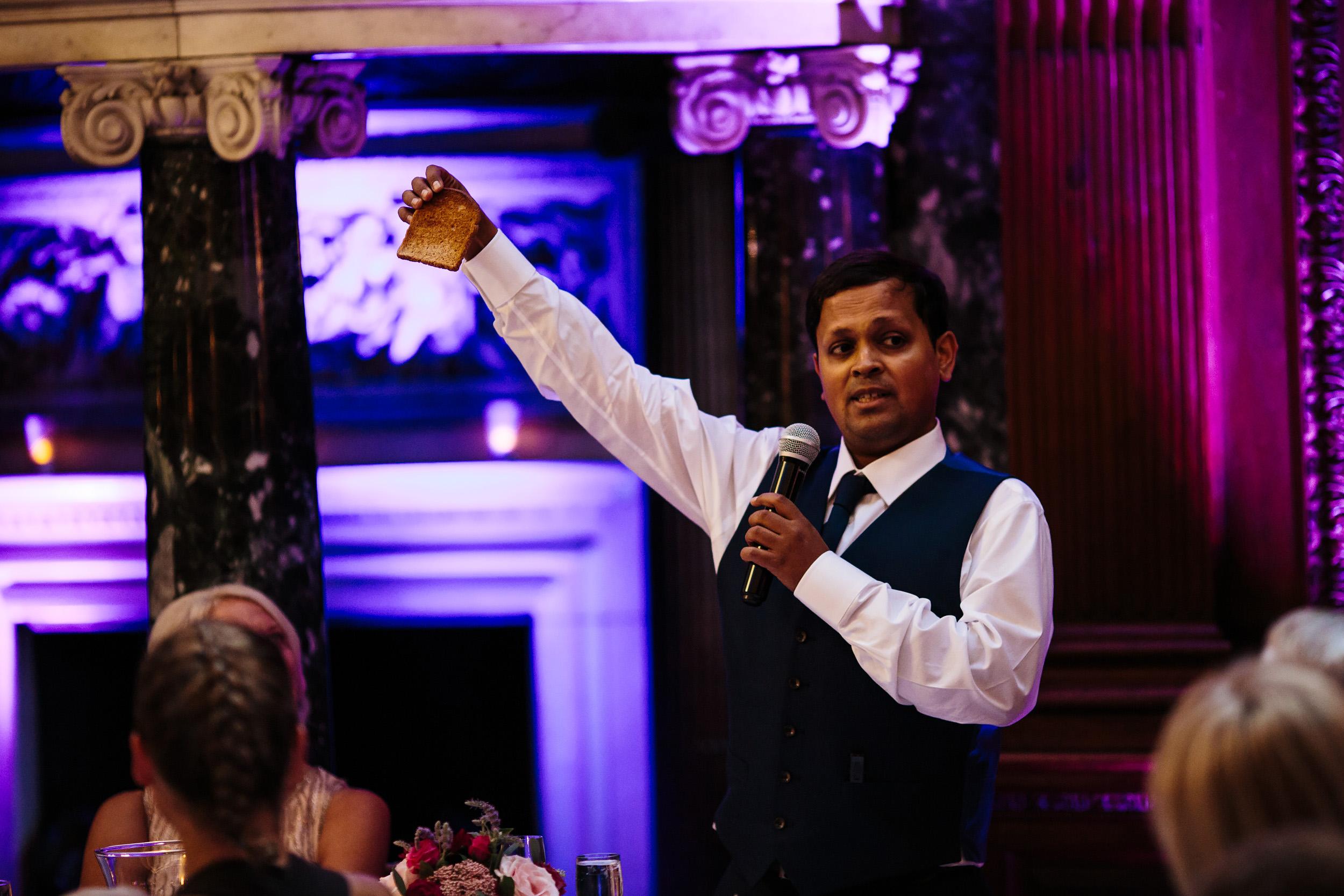 Best man raises a toast during his wedding speech