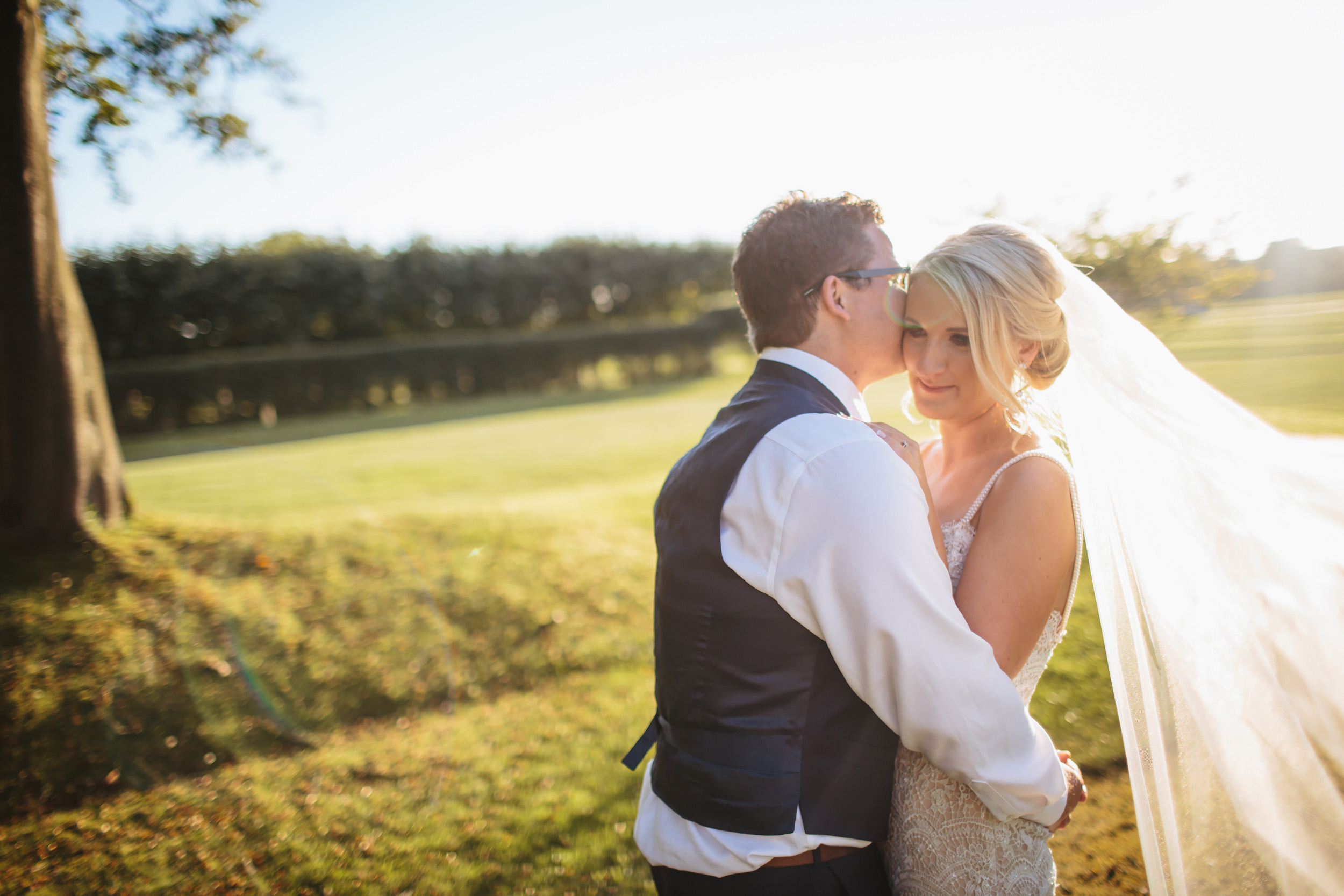 Bride and groom portrait at Thornton Manor Cheshire sunset
