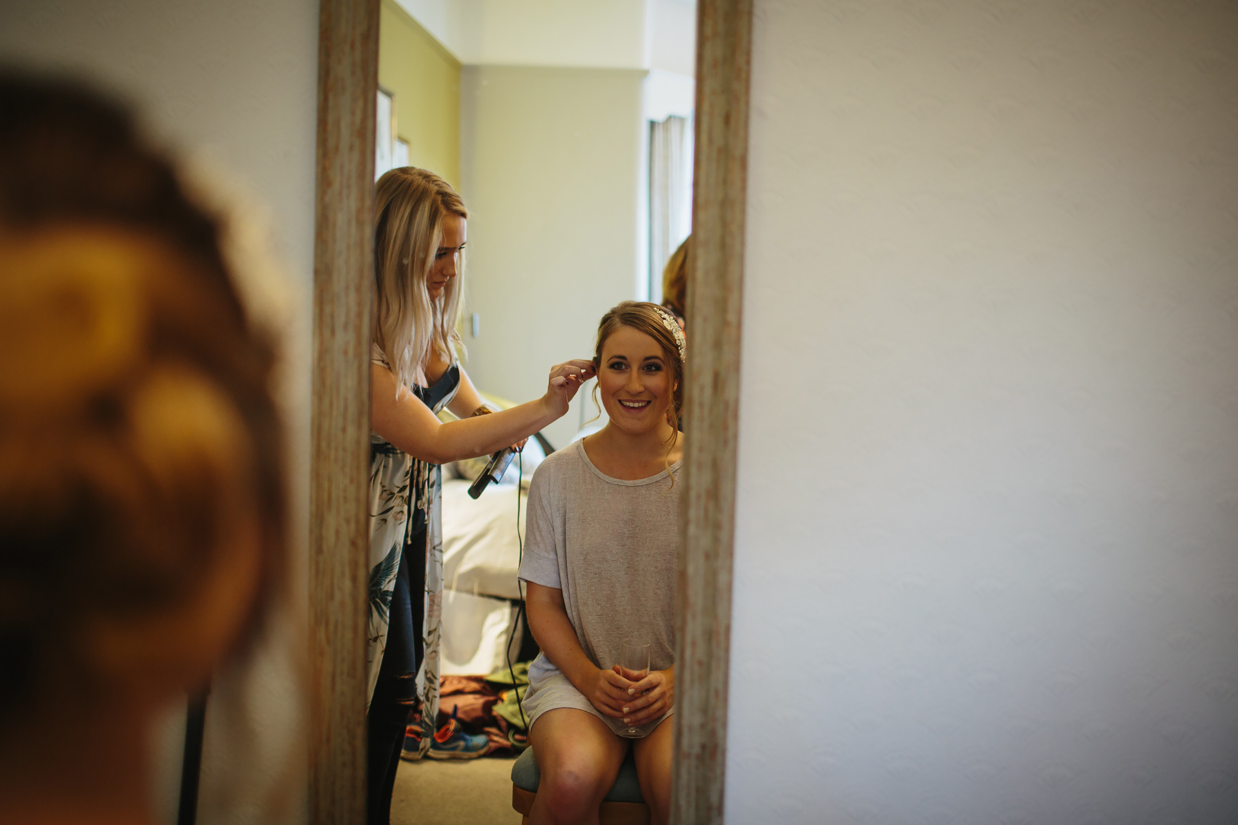 Bride has her hair done for a wedding in Leeds Yorkshire