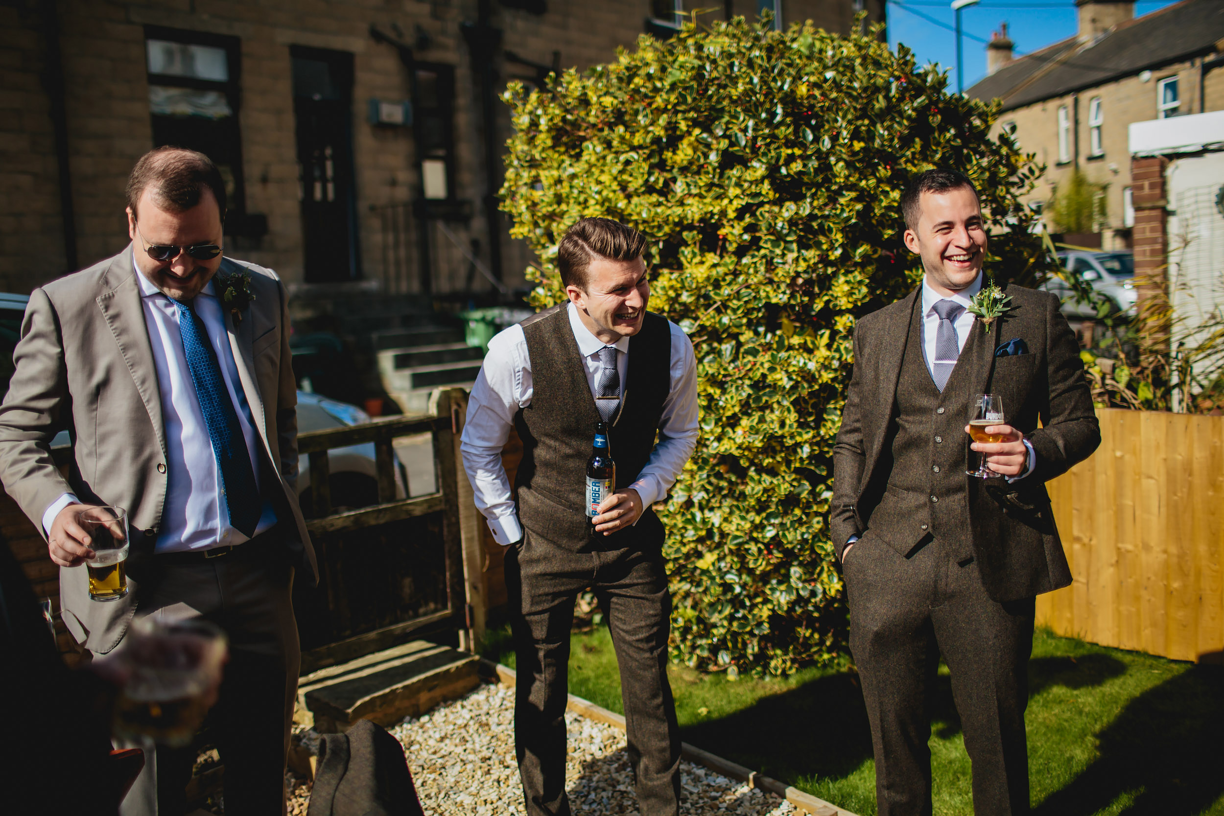 Groom laughing with friends before his Yorkshire wedding