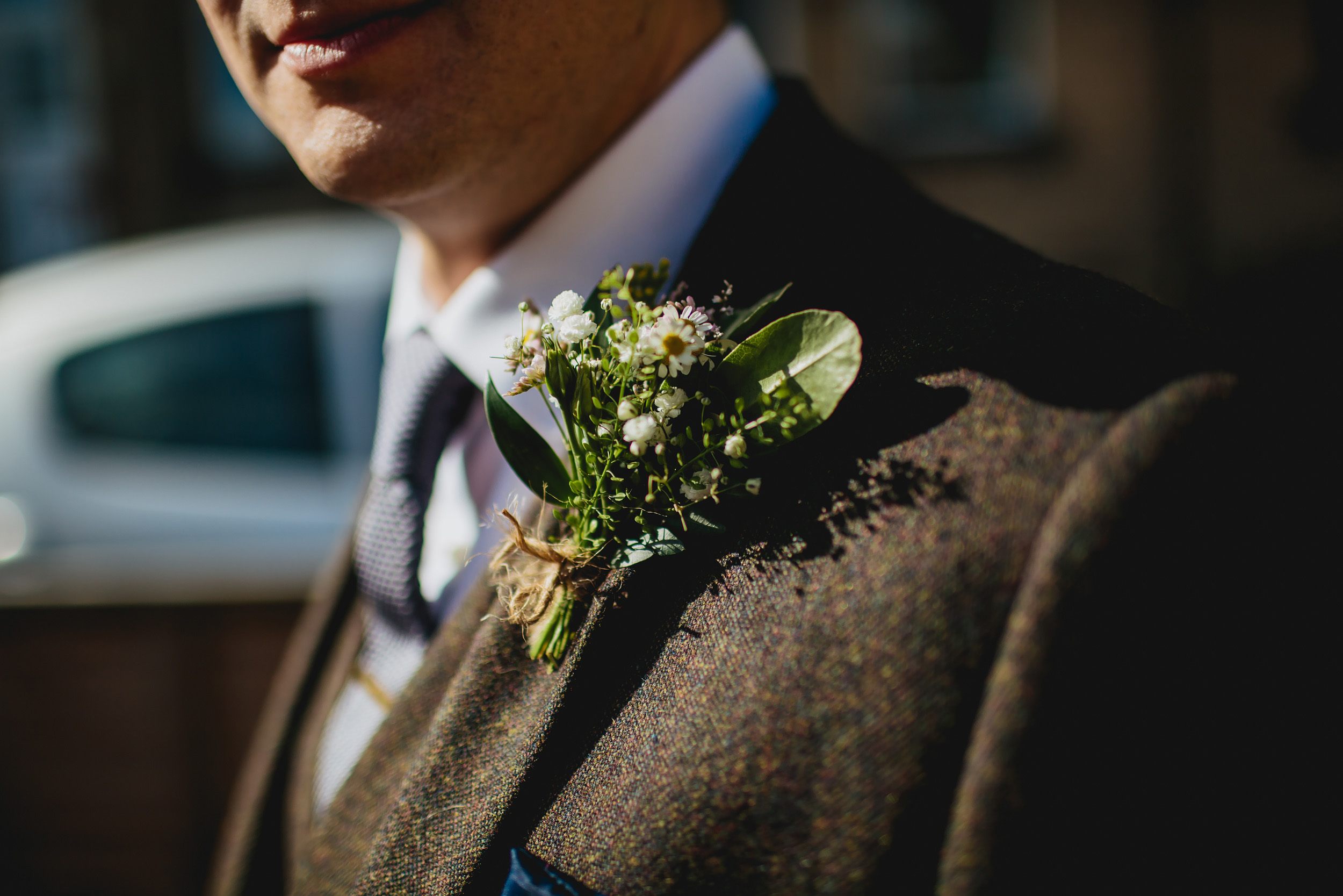 Close up of the grooms buttonhole on his wedding day in Yorkshire