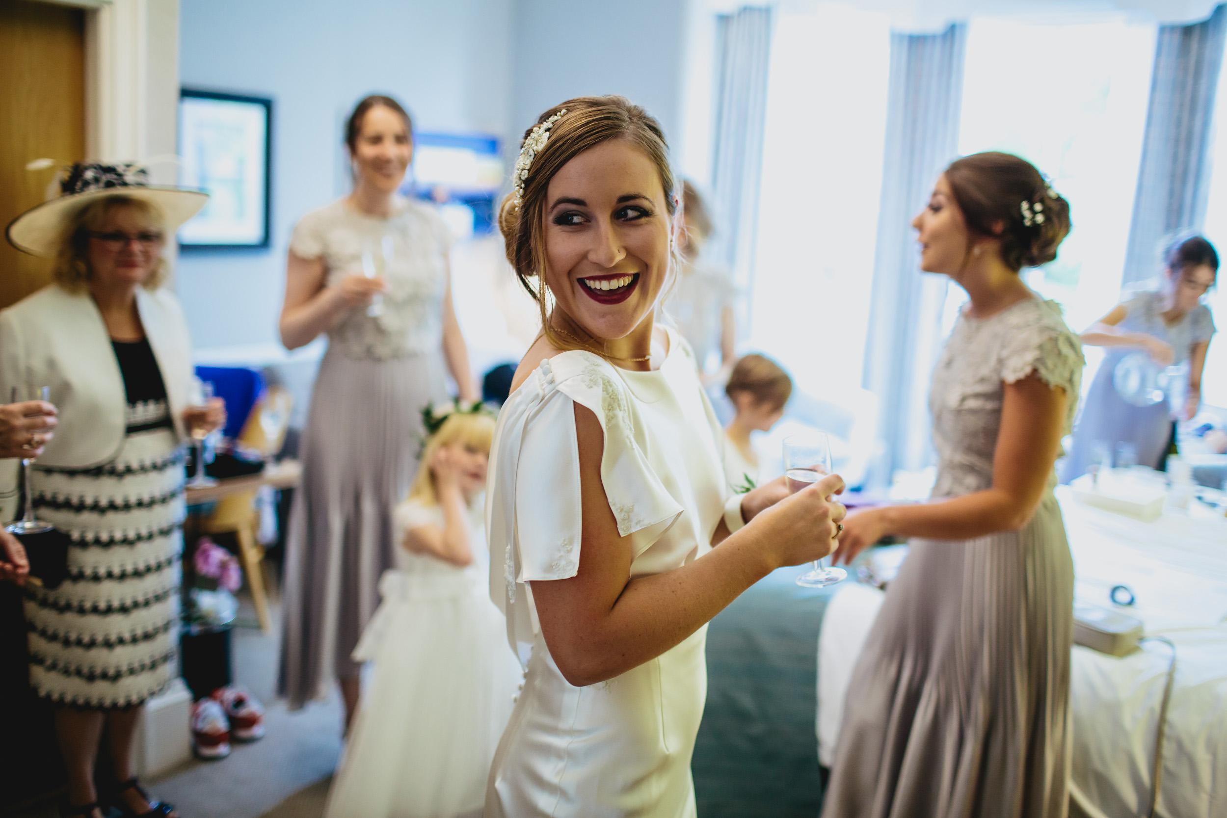 Bride smiling in her wedding dress in Leeds