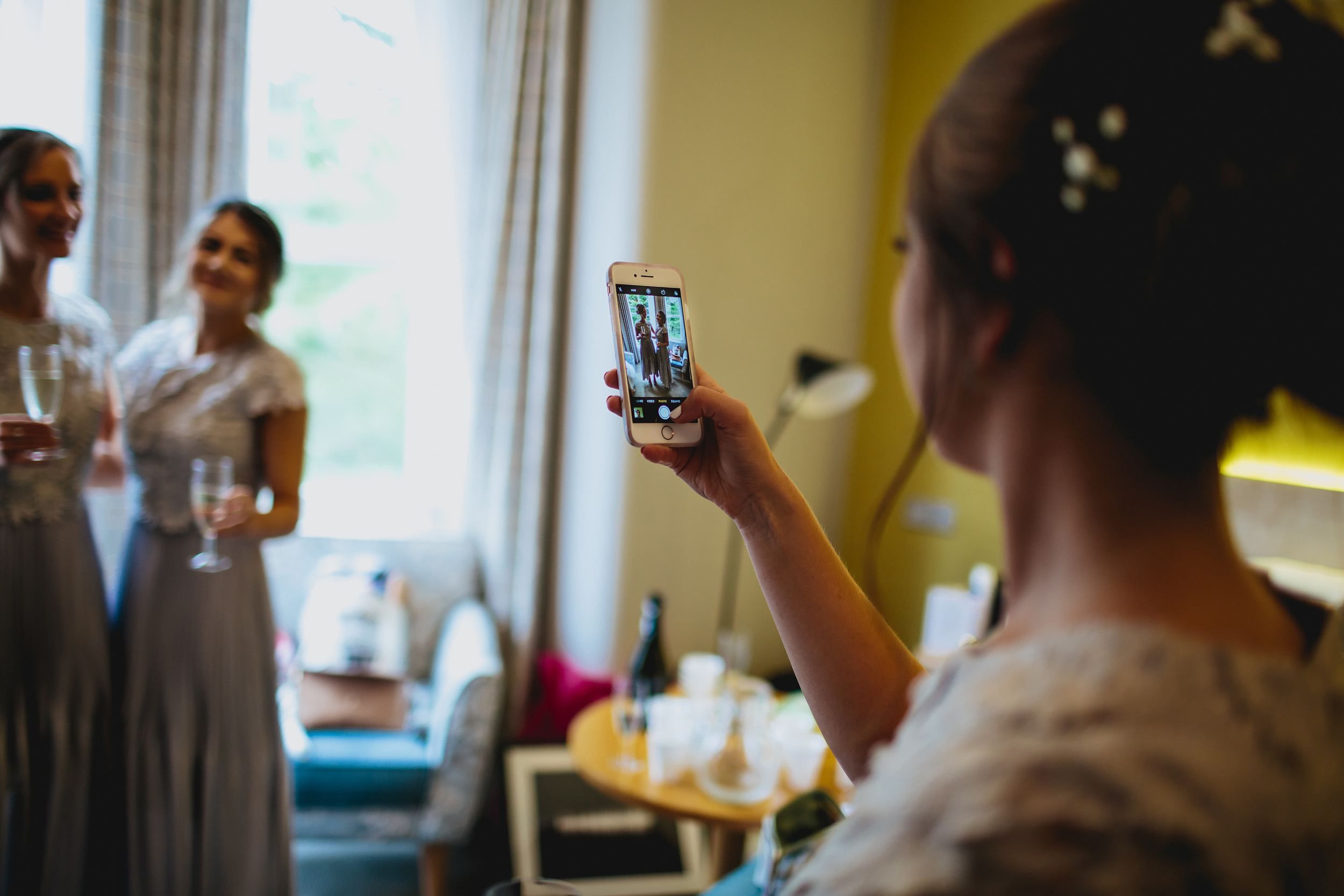 Bridesmaid taking photos of others at Yorkshire wedding