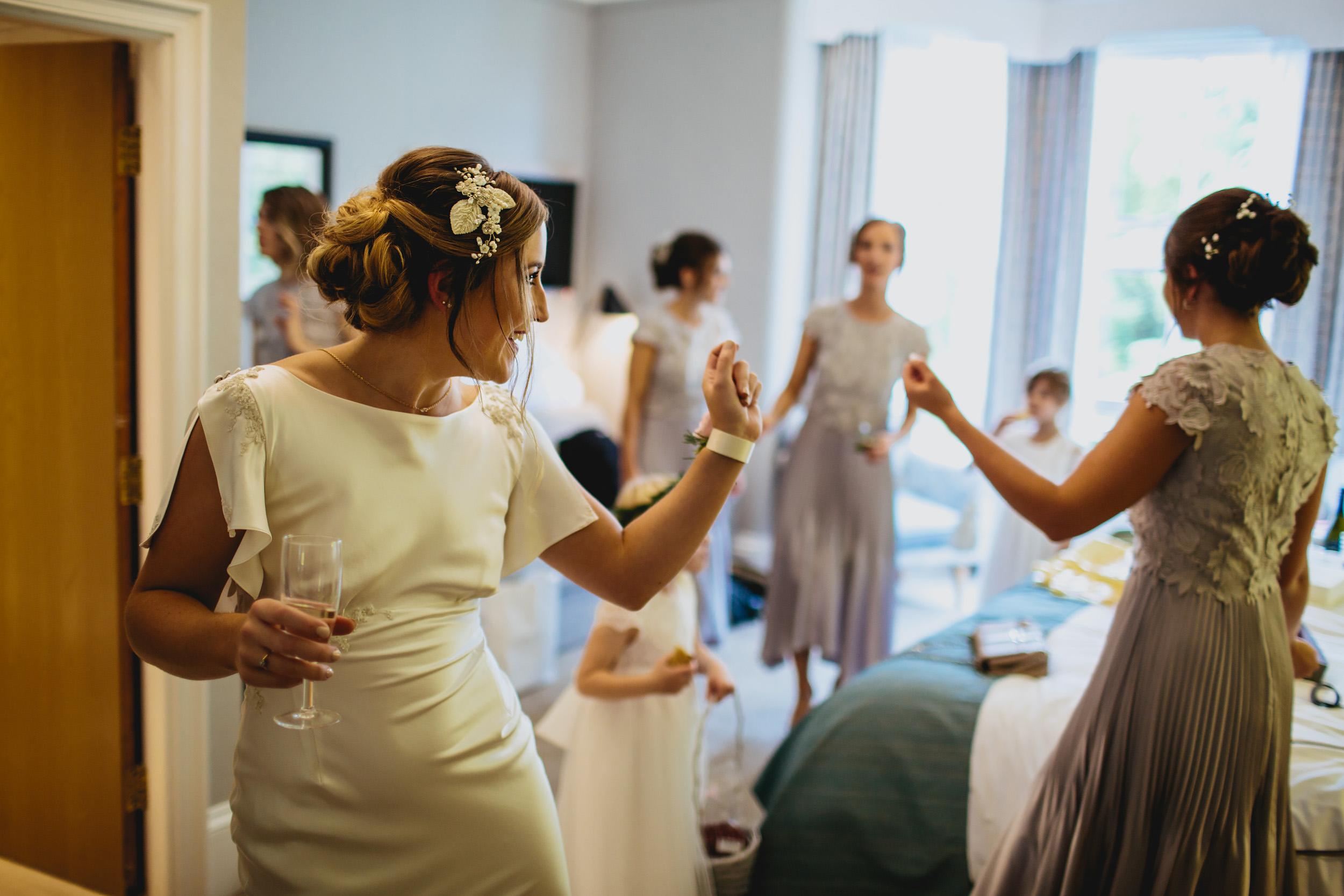 Bride dancing before her wedding in her dress in Yorkshire