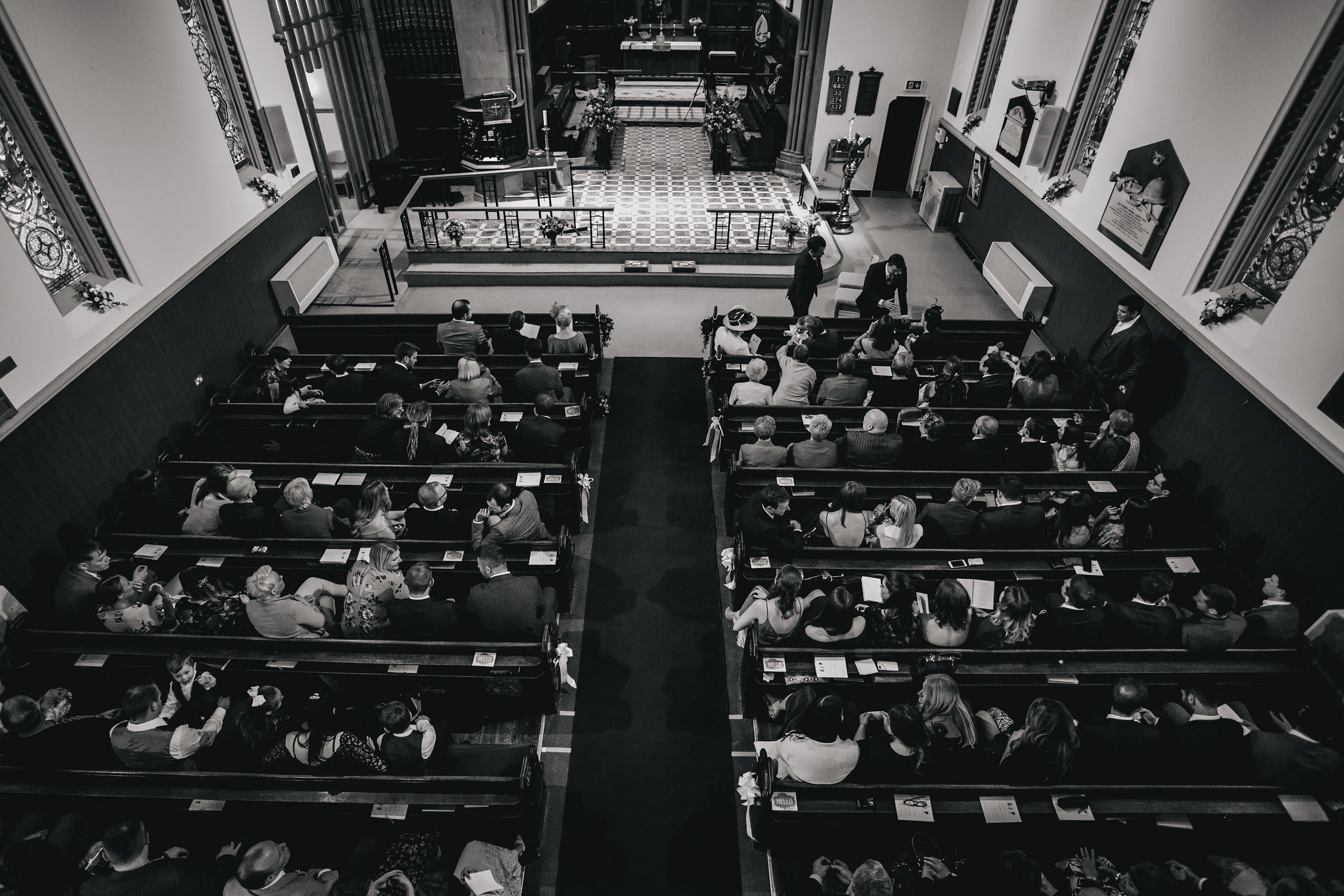 Wedding guests at a church ceremony in Leeds