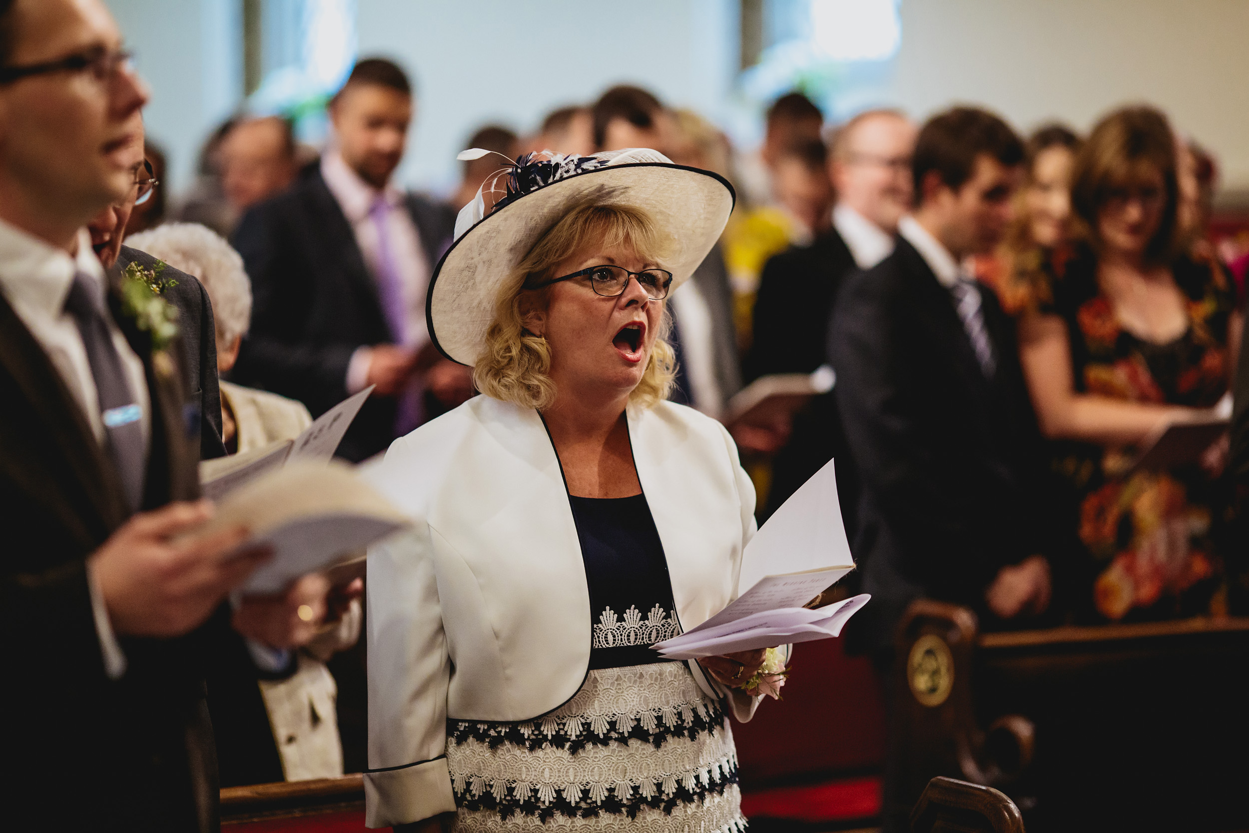 Brides mother singing hymns at the church ceremony wedding