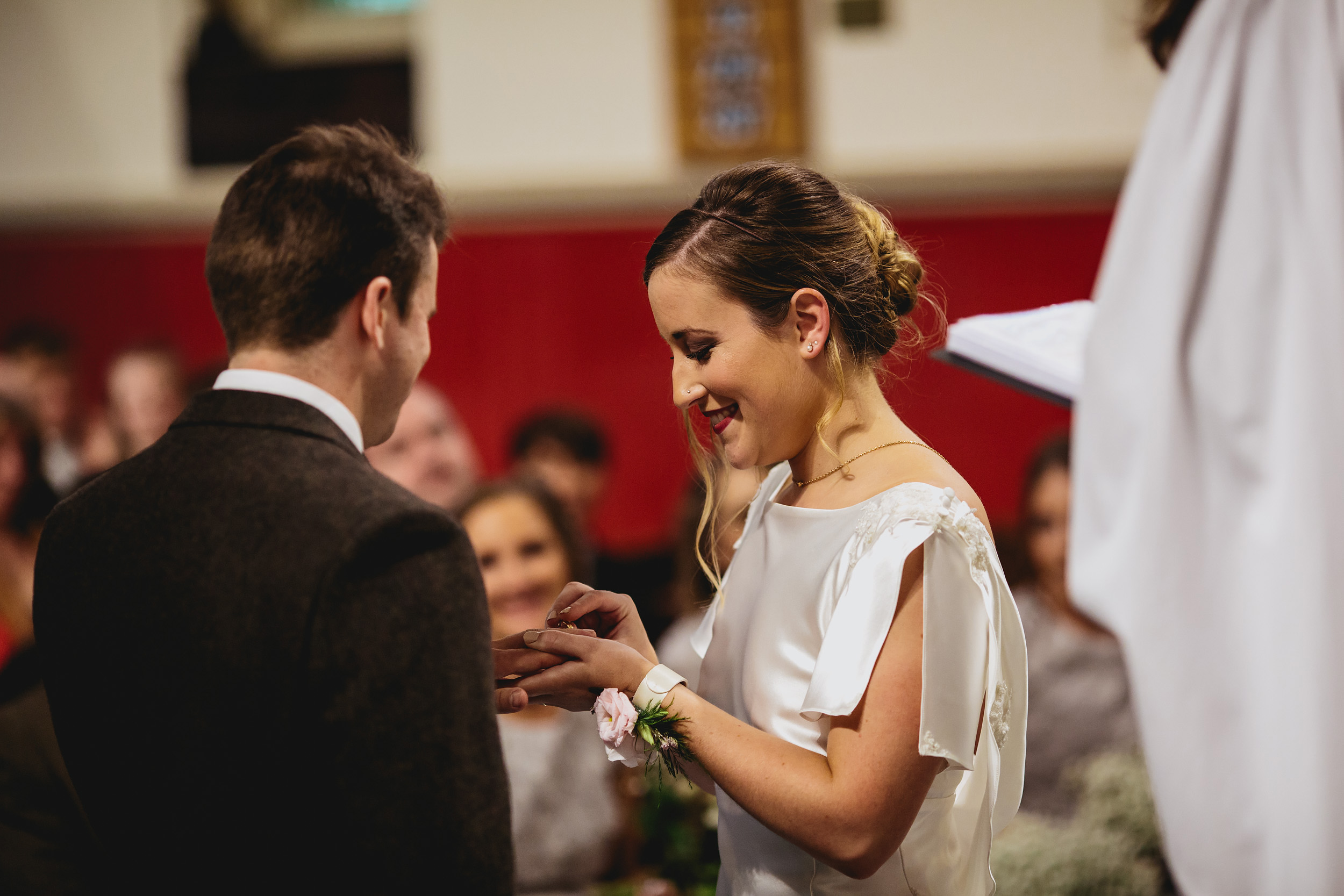 Bride and groom exchange rings at the church