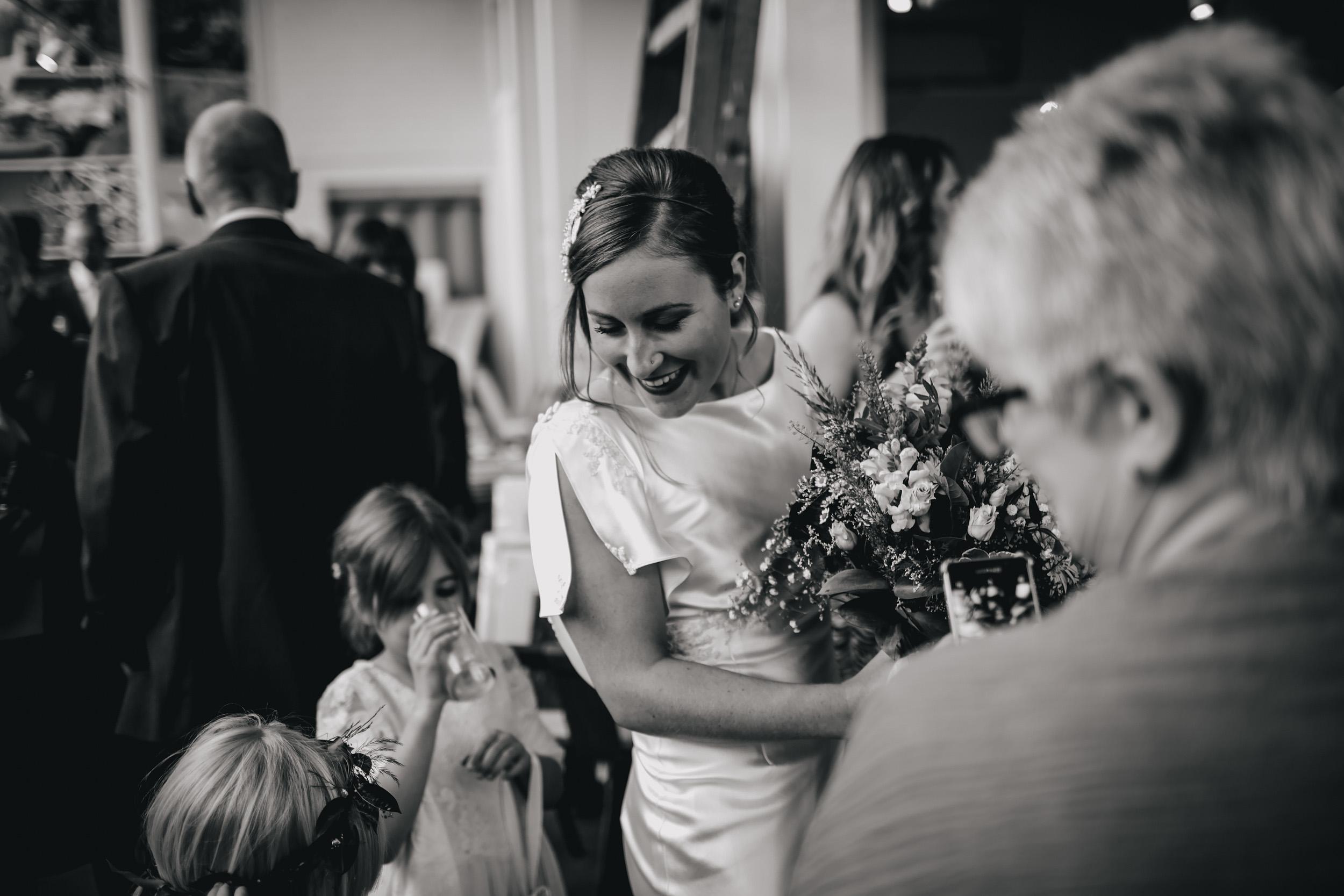Bride laughing at a Sunny Bank Mills wedding