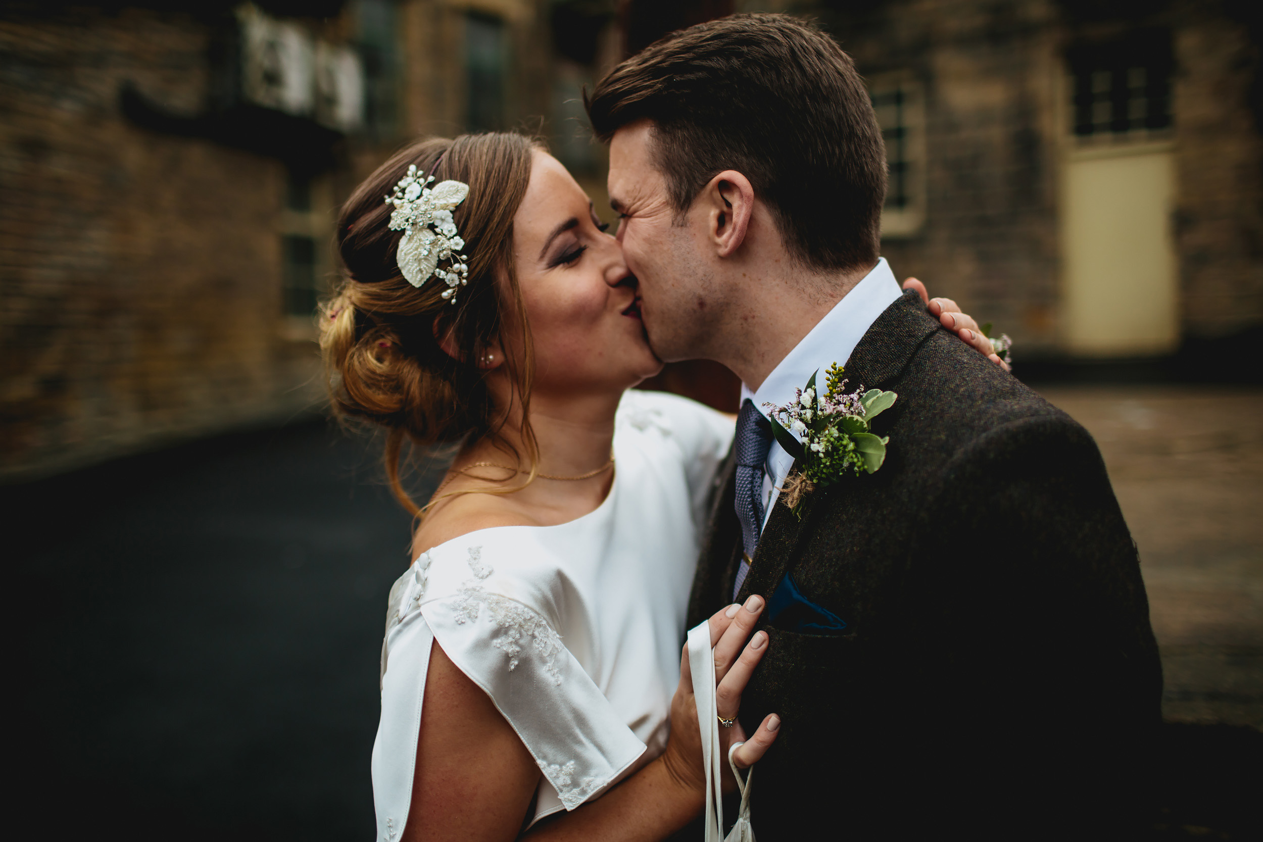 Bride and groom kiss at Sunny Bank Mills Leeds