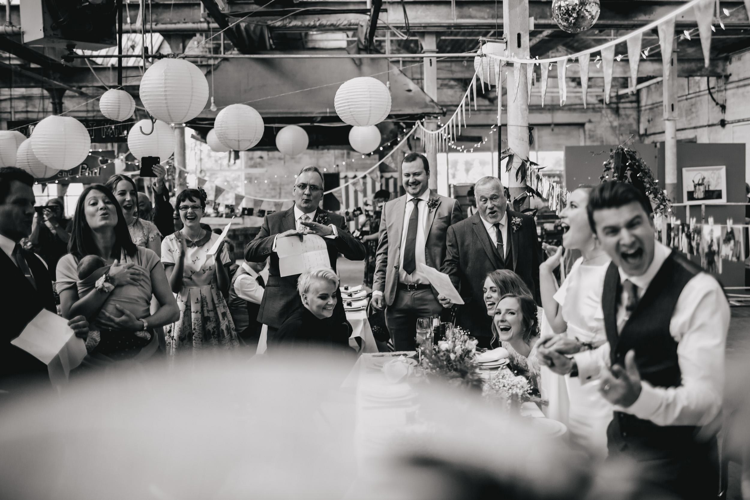 Wedding guests singing at Sunny Bank Mills