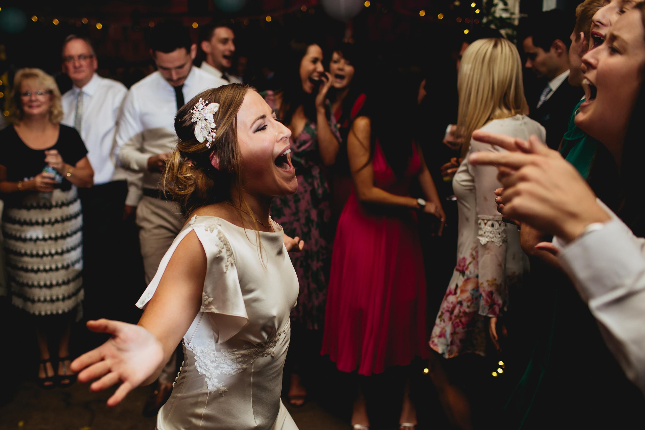 Bride dancing at her wedding at Sunny Bank Mills