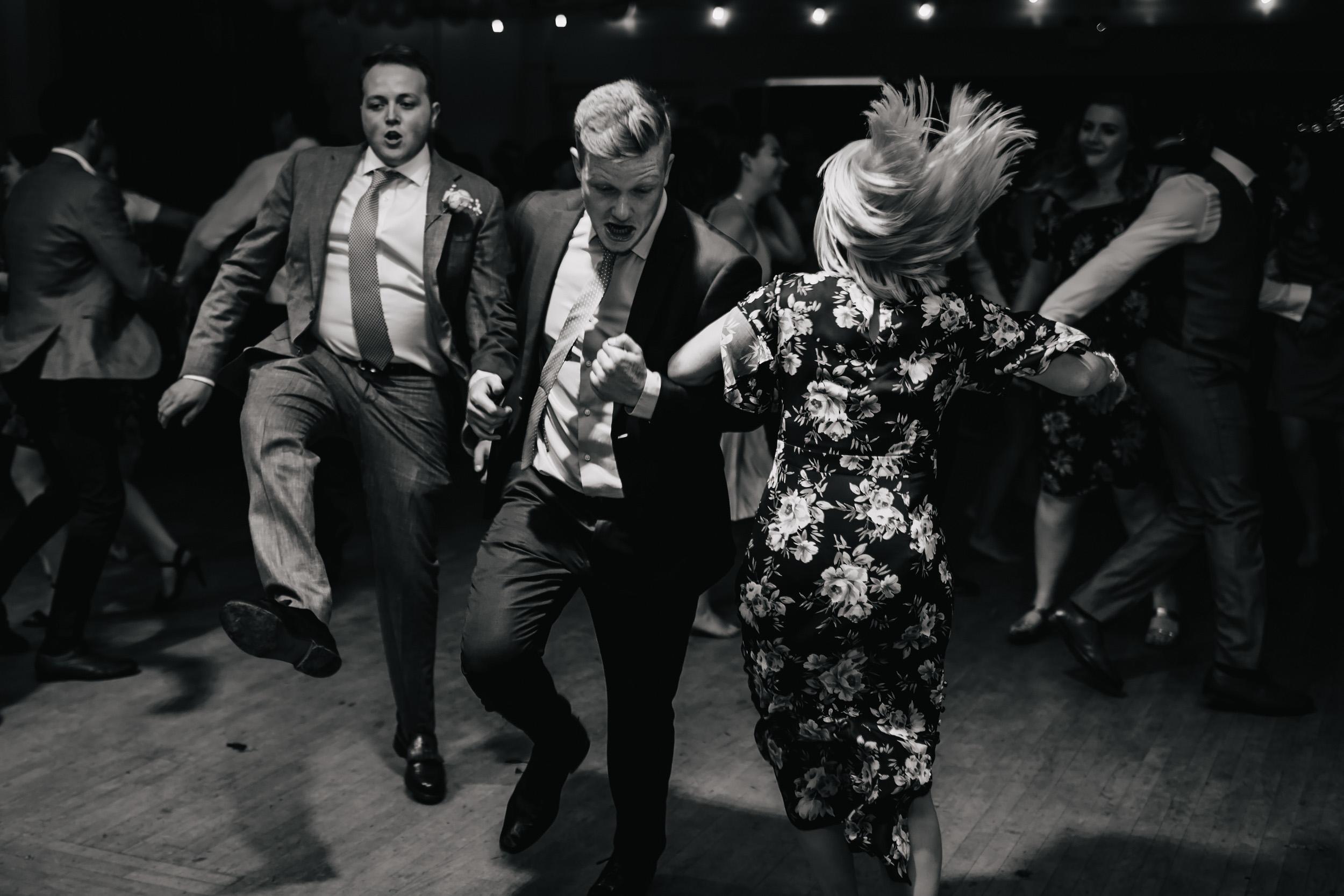 Wedding guests ceilidh dancing in Lancashire