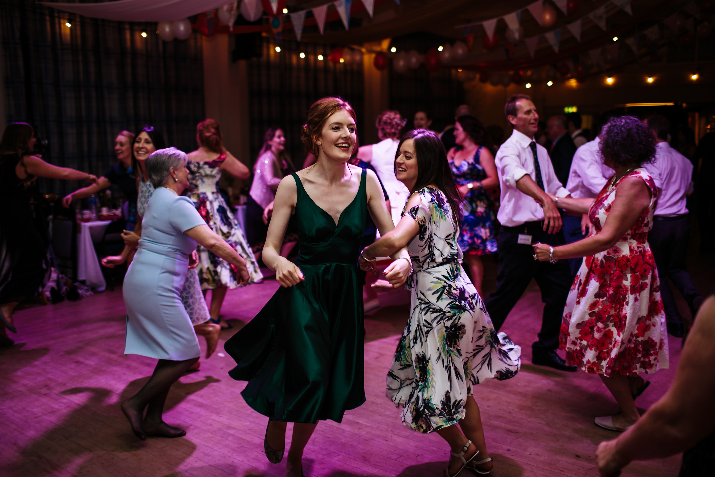 Wedding guests dance at a ceilidh in Lancashire