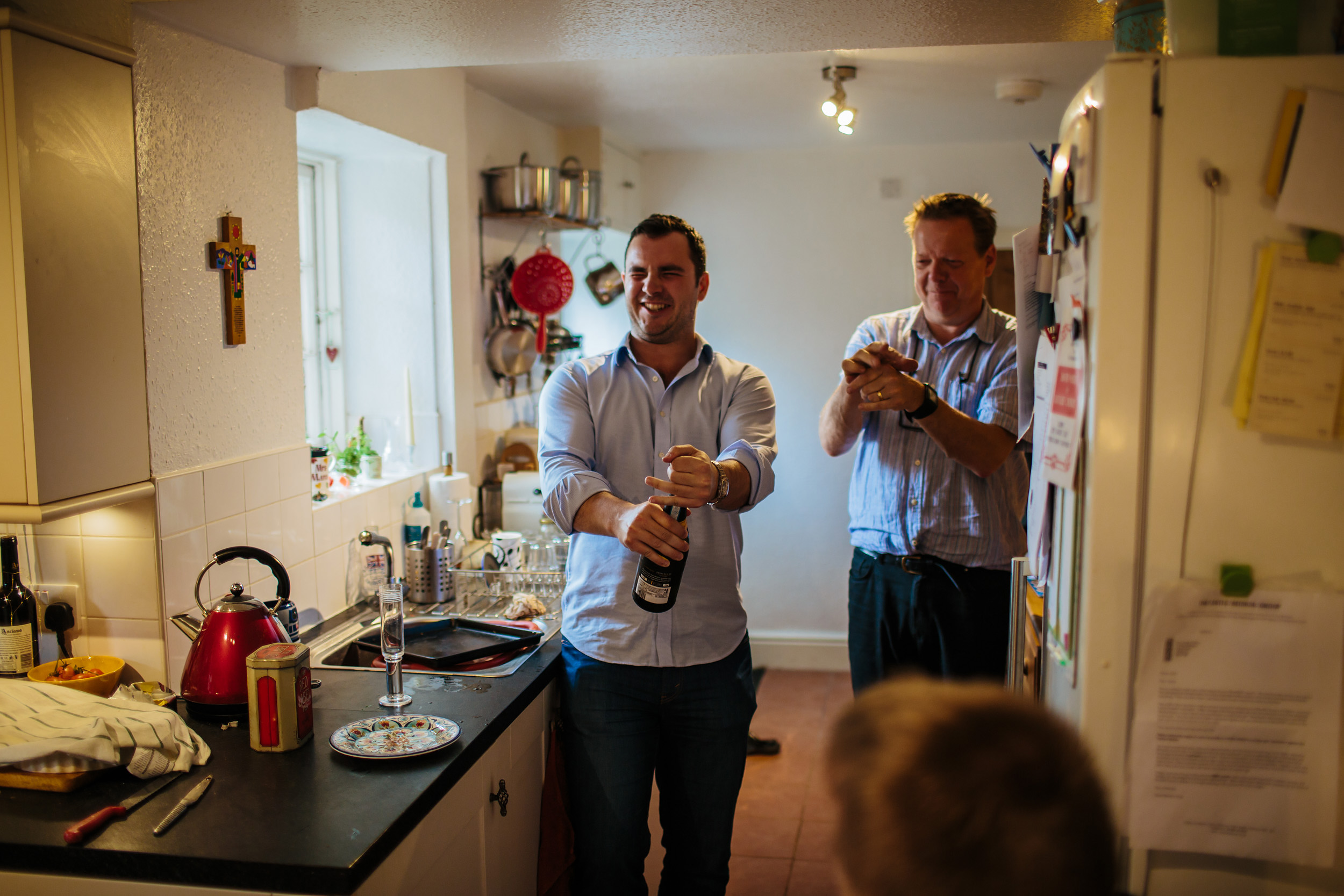 Popping a champagne cork before a wedding in Lancashire