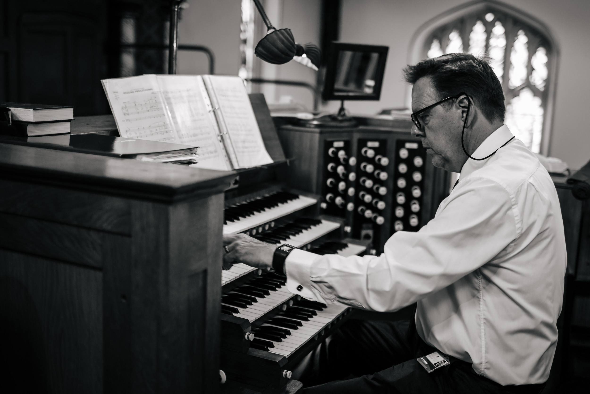 Church organist performs at a wedding at Stonyhurst College